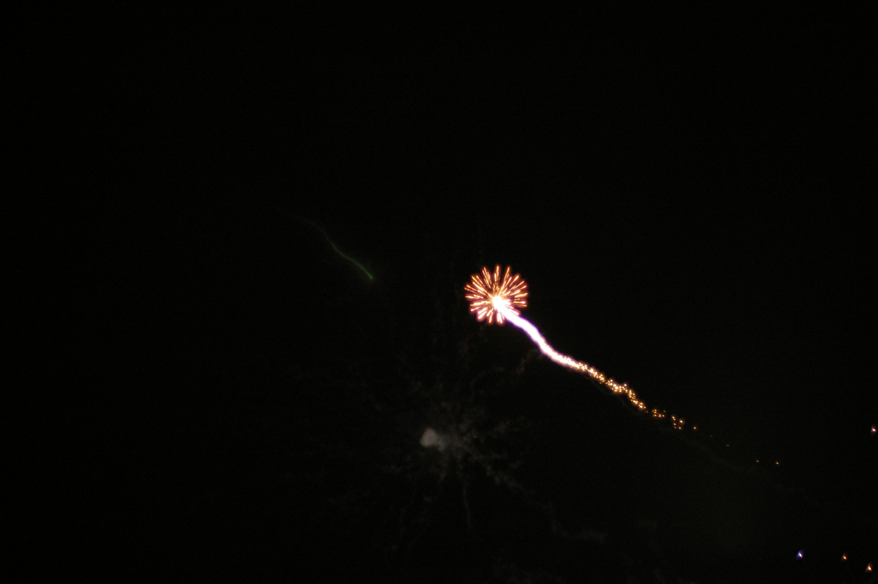 a single firework shooting into the sky
