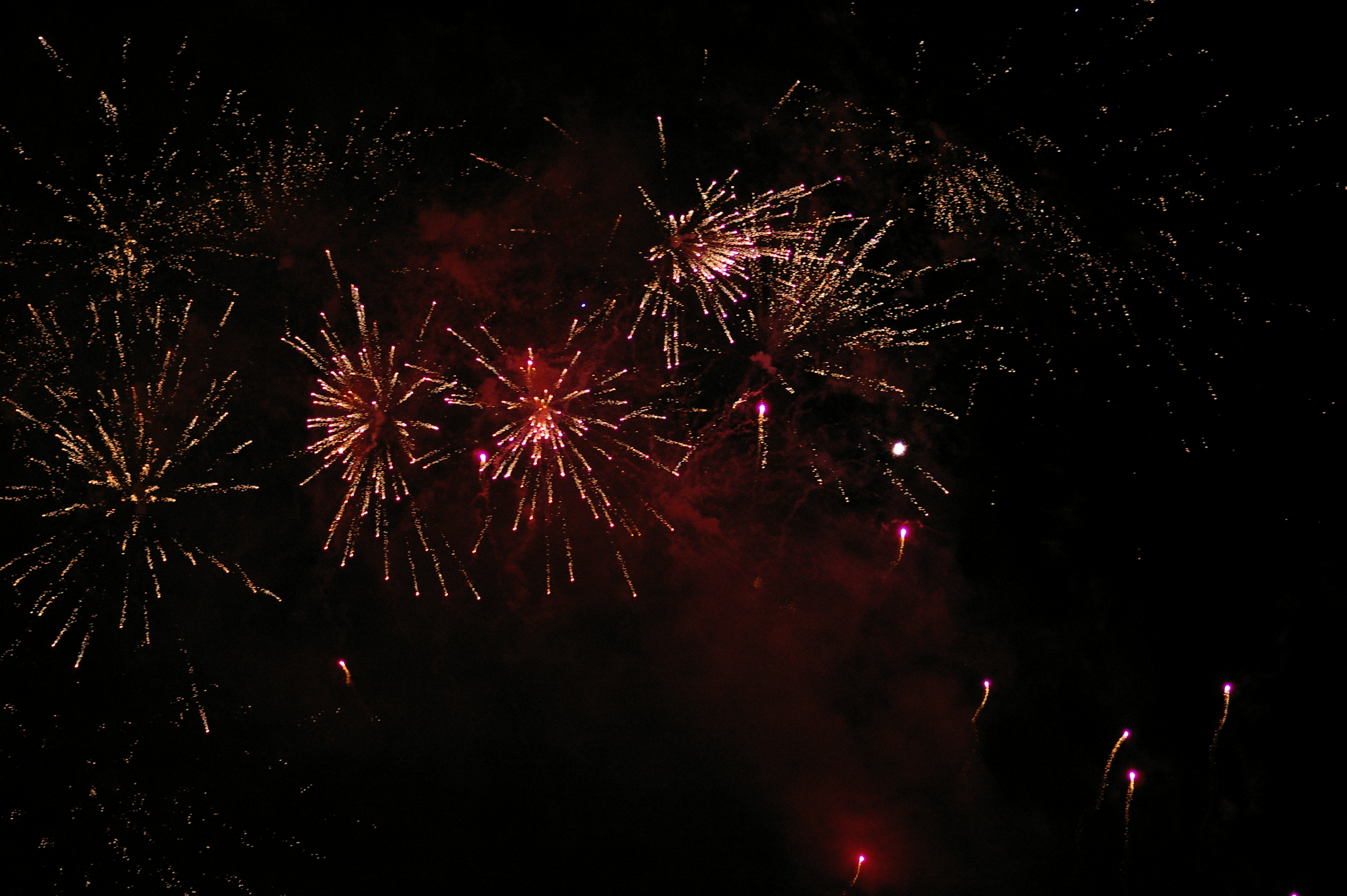 exploding firework rocket display, pyrotechnic trails