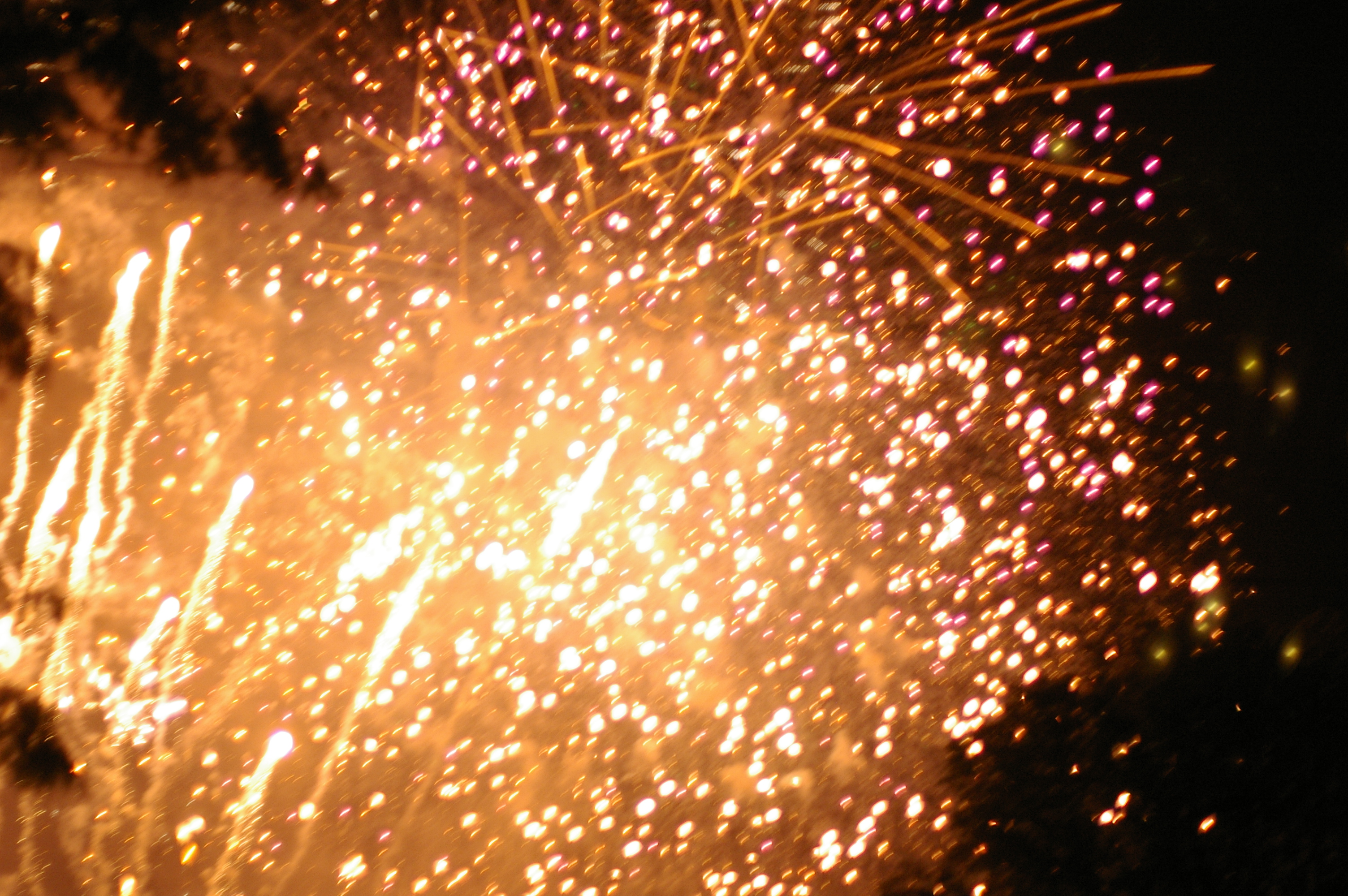 a firework display of yellow glowing sparks