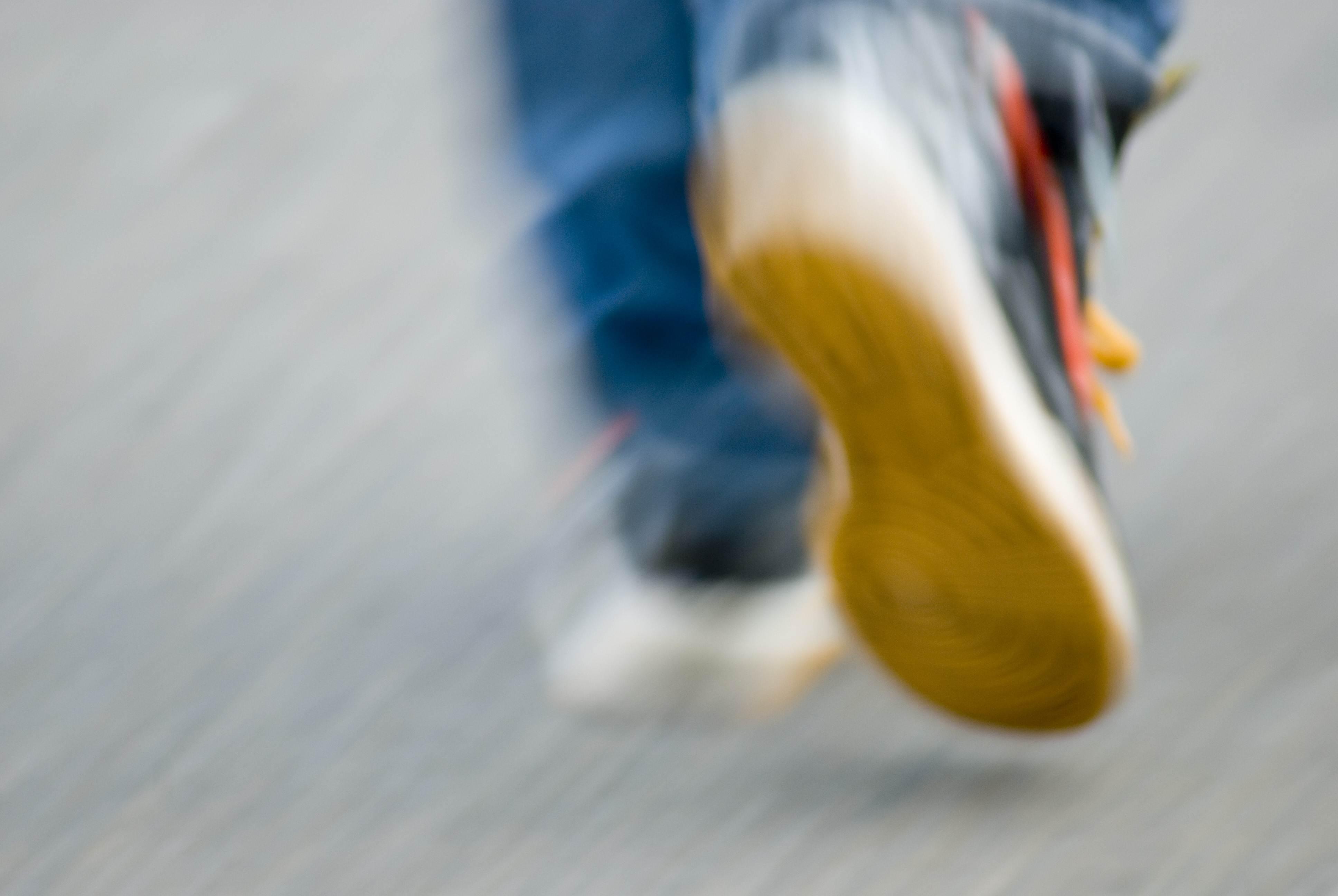blurred motion image of walking feet