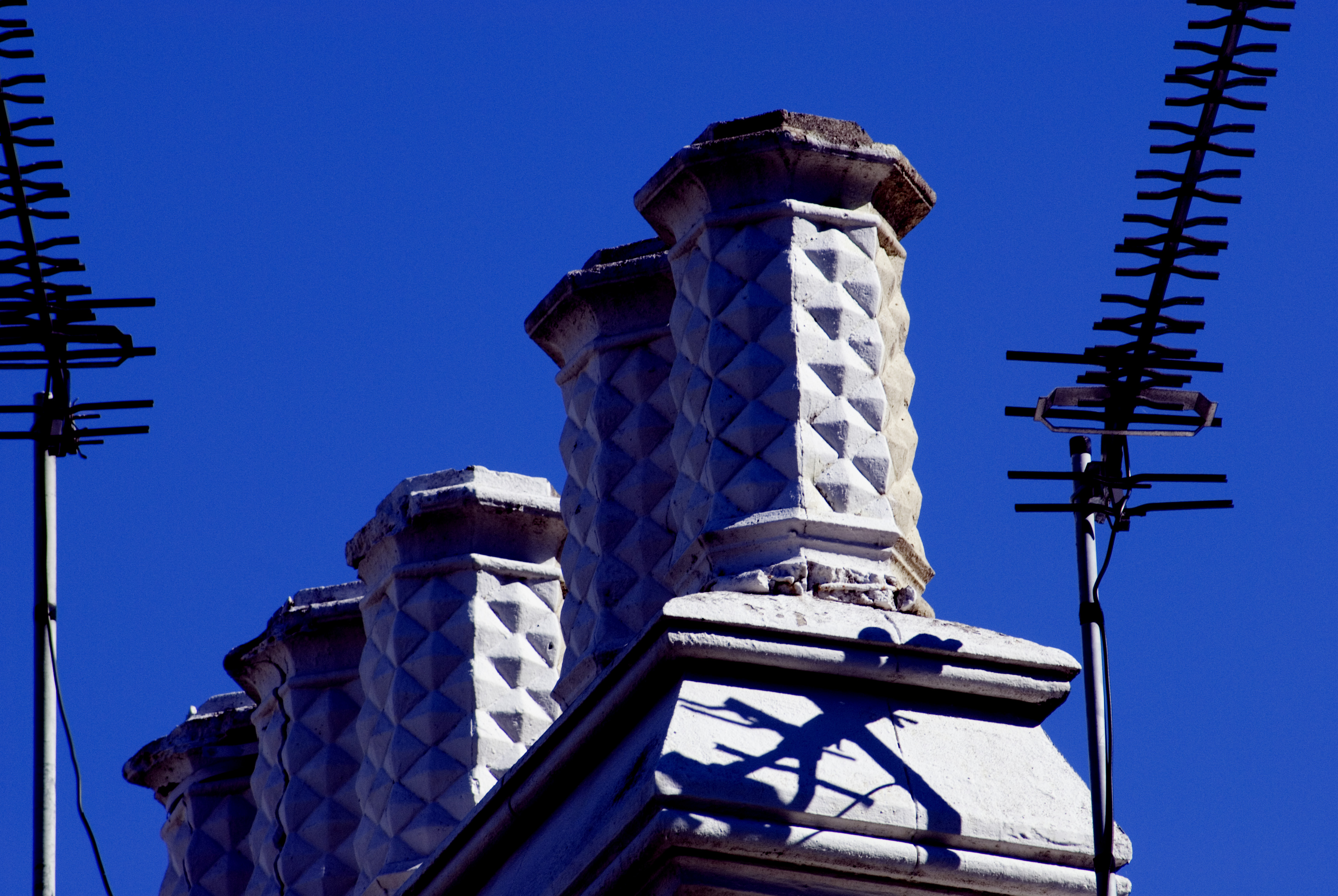detail of a roof top against a vivid blue sky