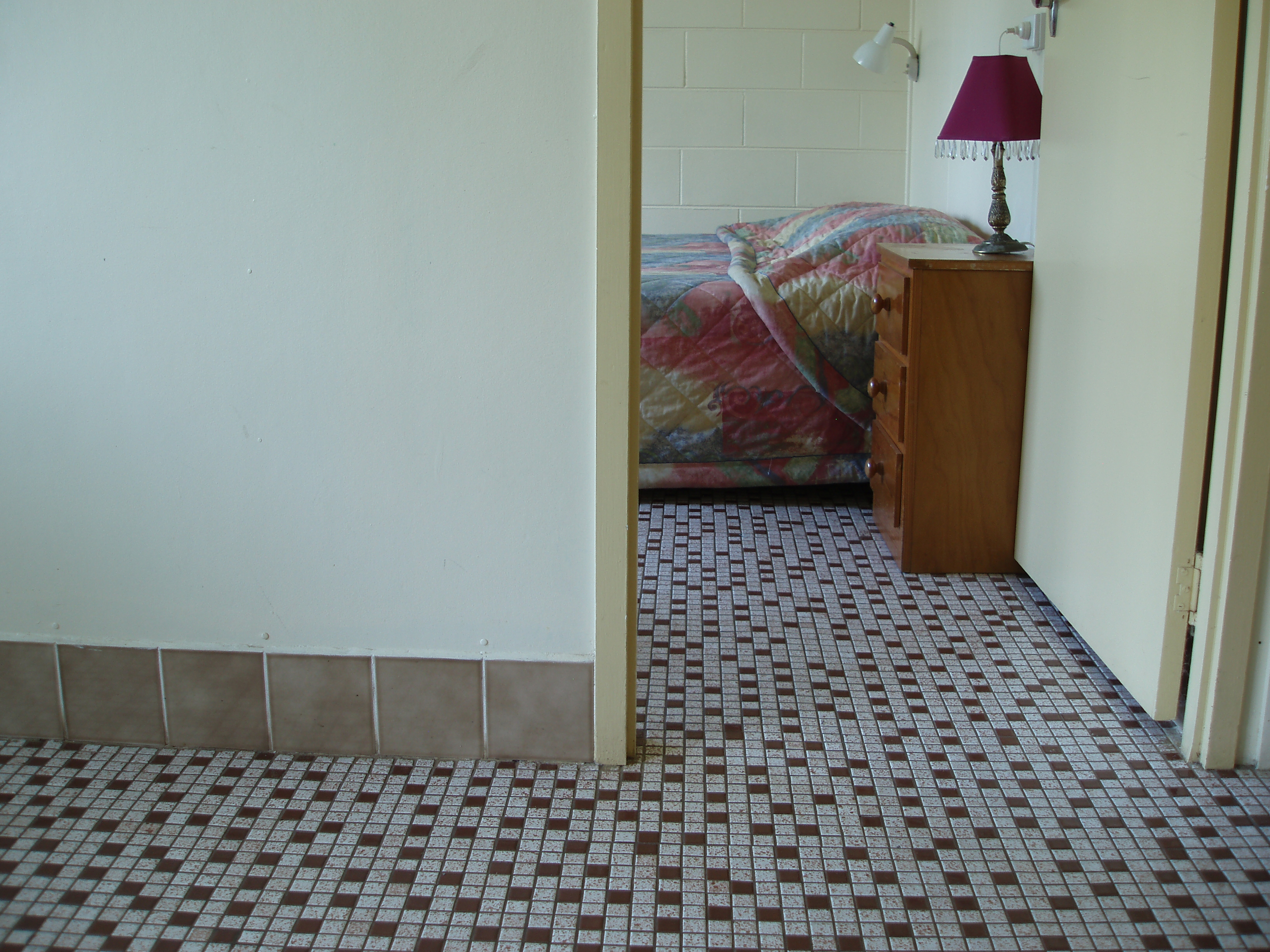 mosaic floor in interior of a motel