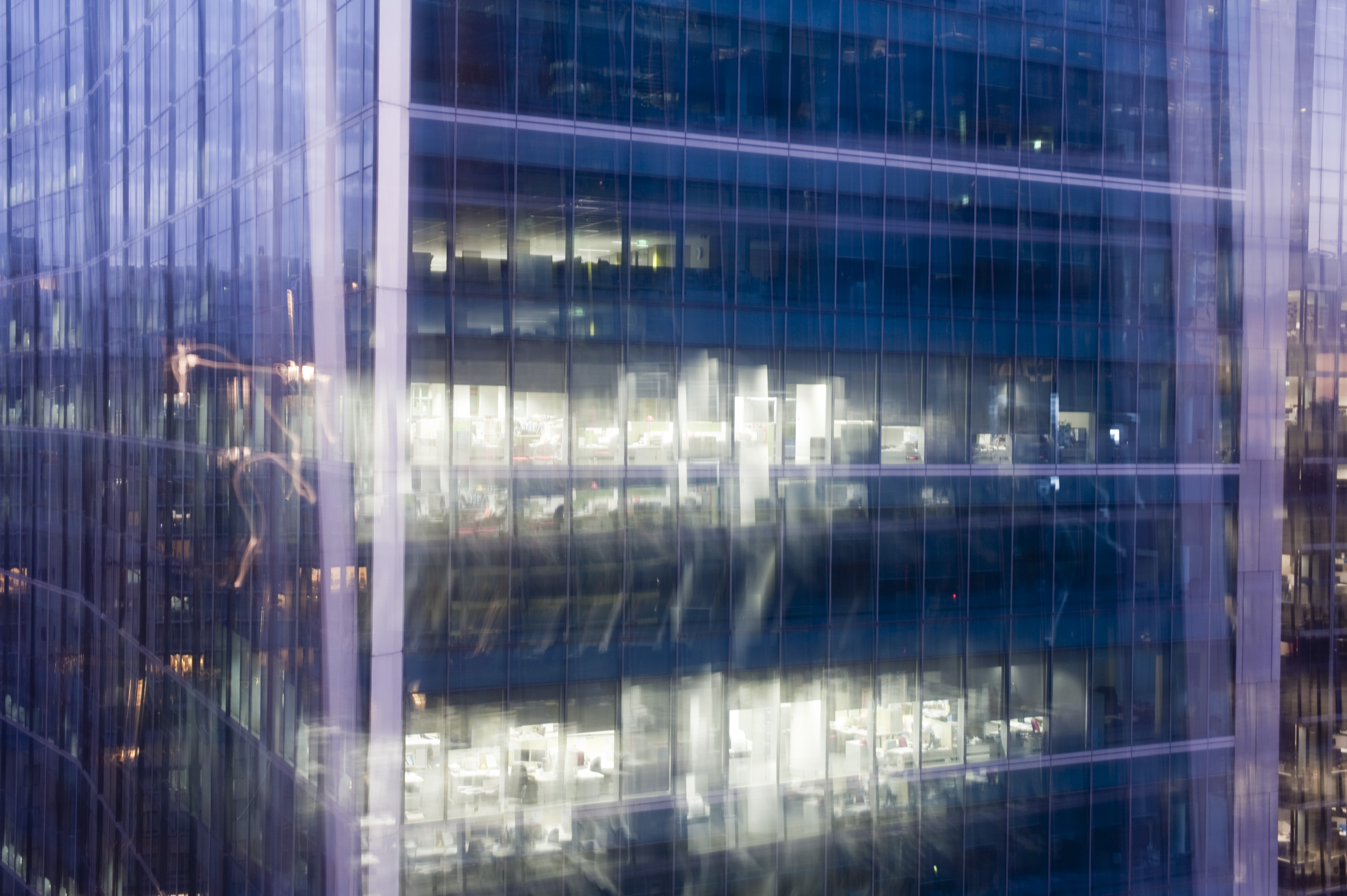 modern office building with abstract multiple exposure and glowing light effect