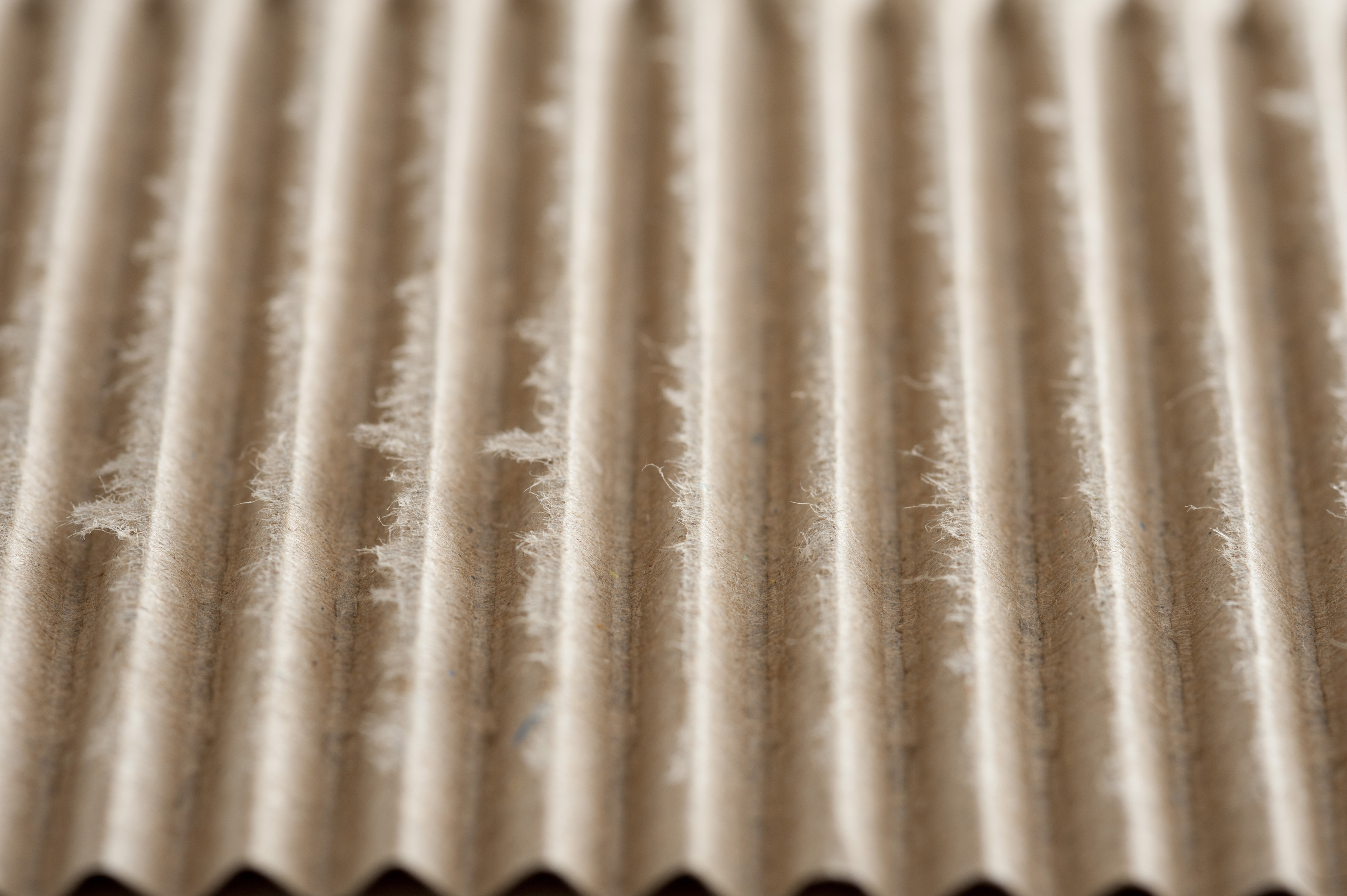 Recycled corrugated brown paper for packaging in a full frame oblique angle view