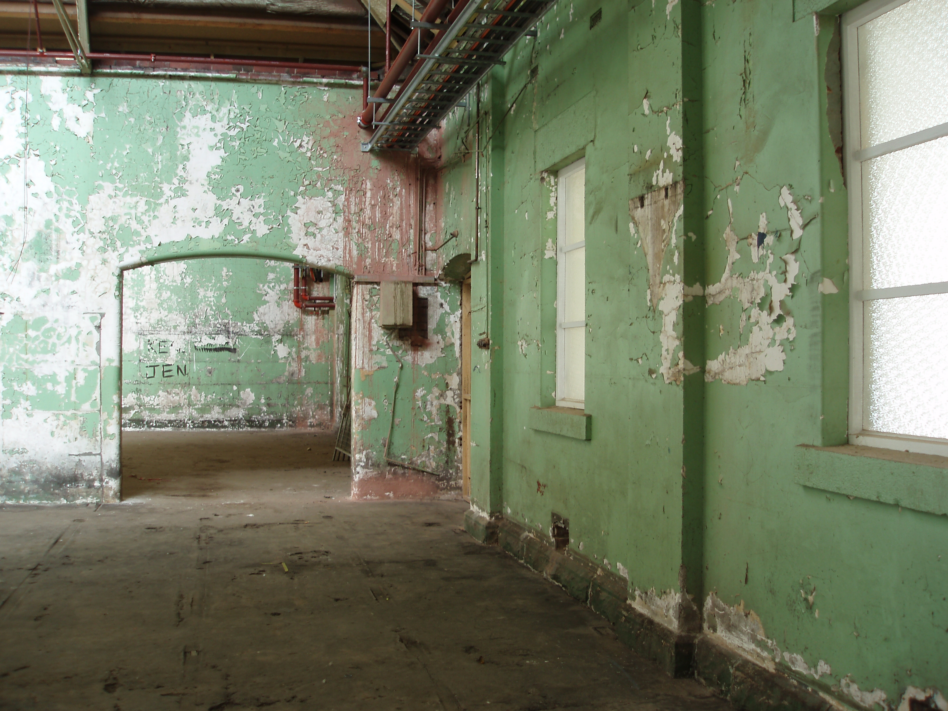interior of an old building with paint flaking from the walls
