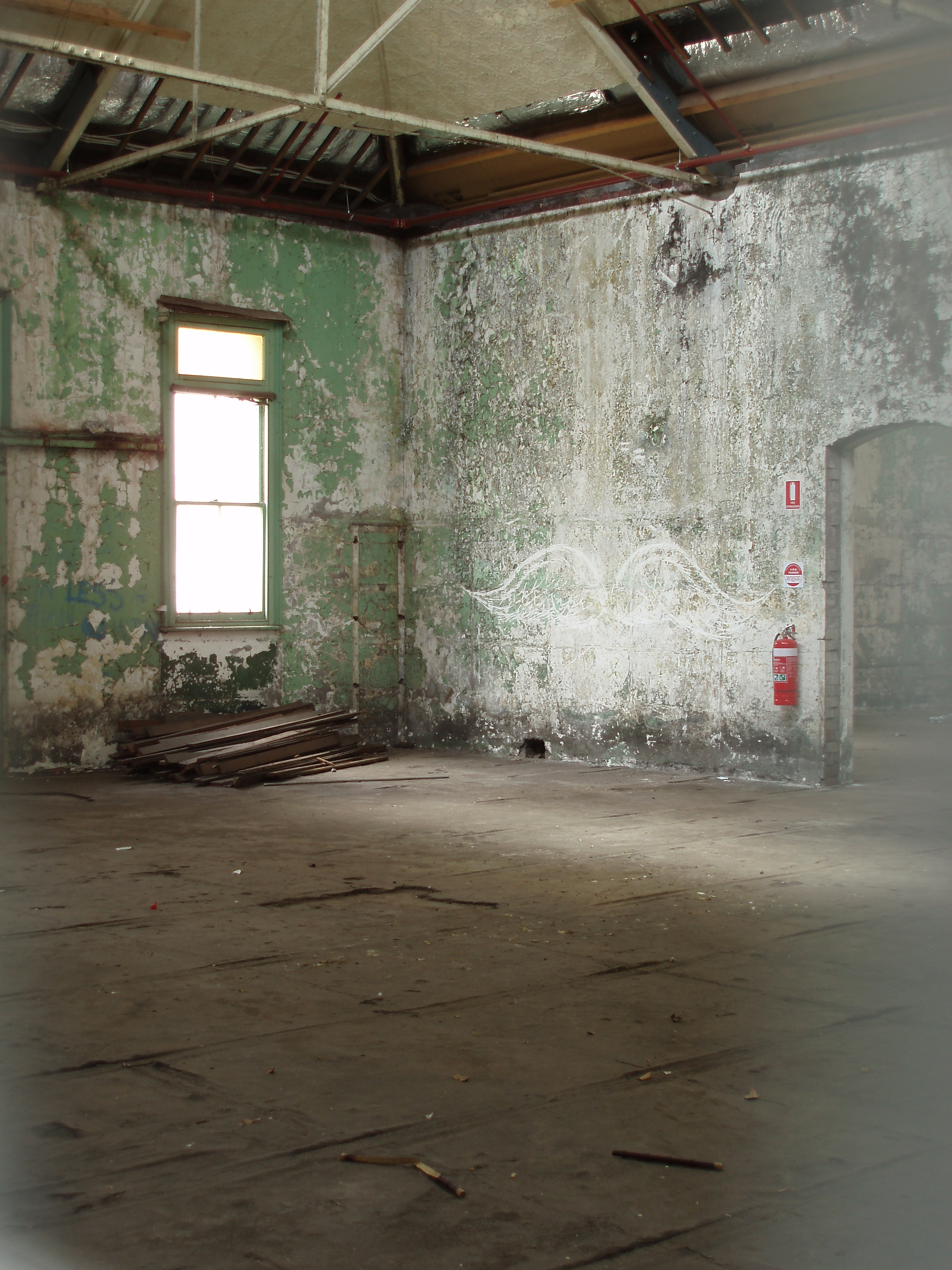 old derelict building interior with paint flaked walls