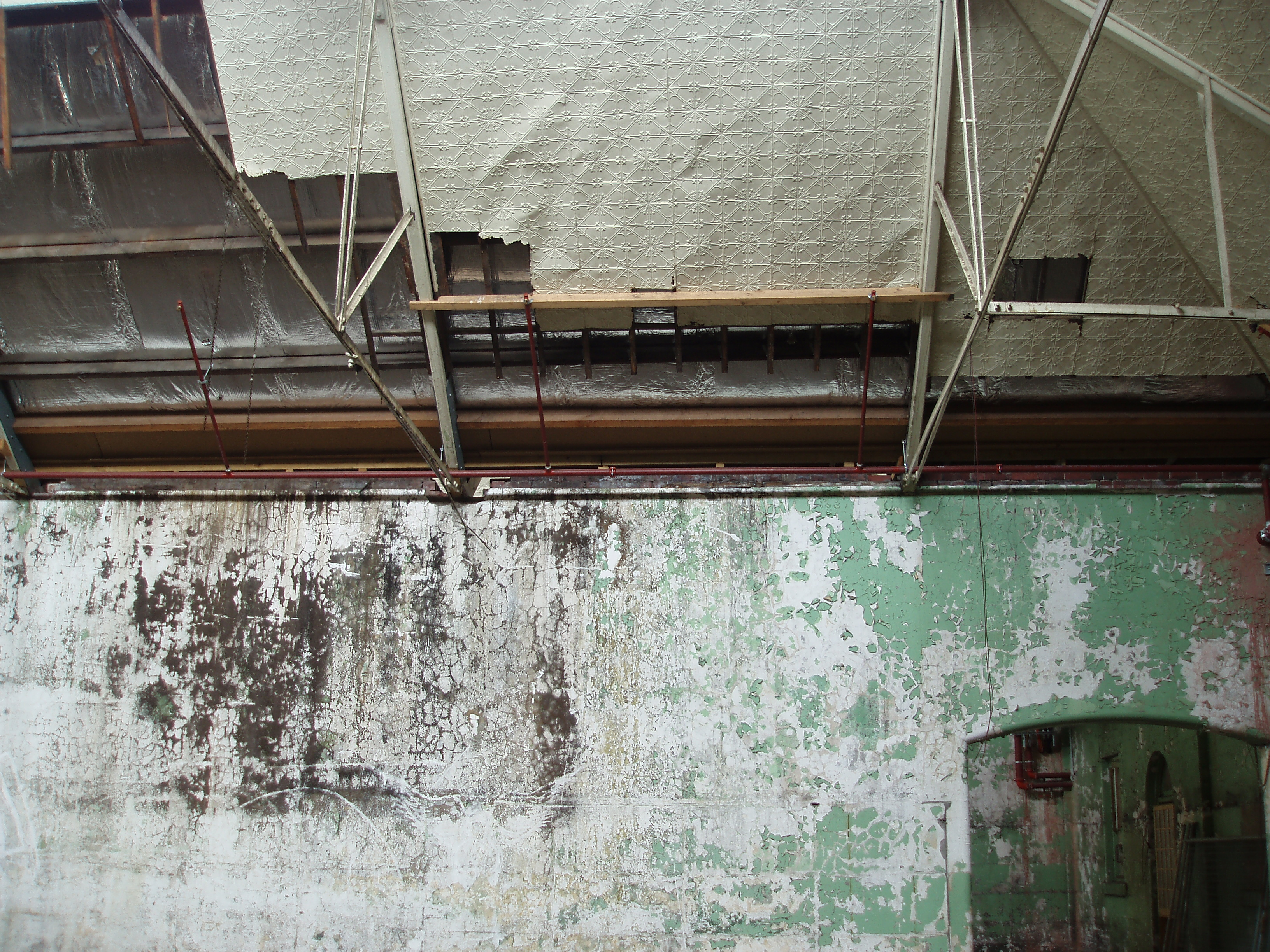 an old building interior with falling roof