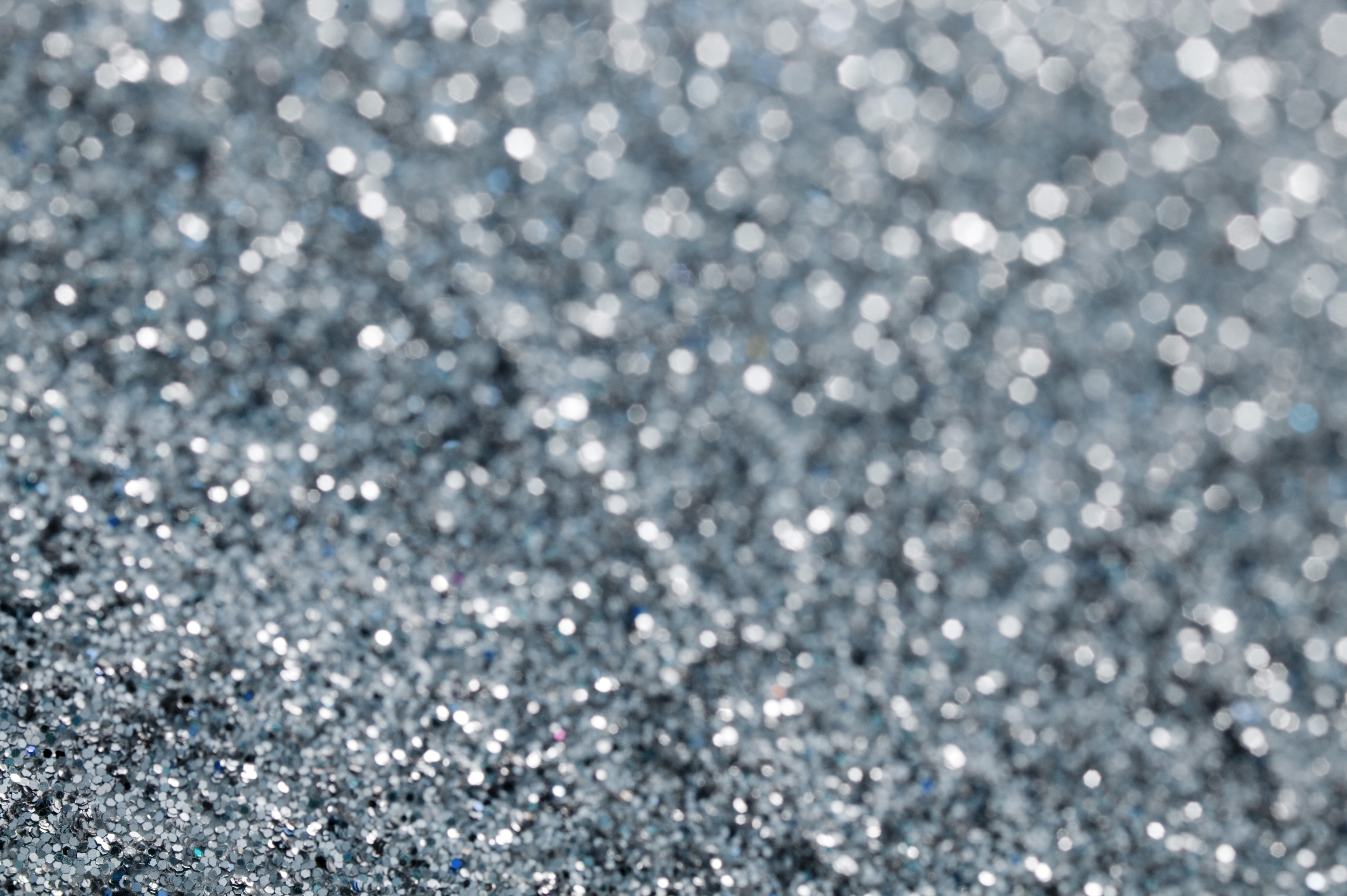 Grey gravel background with light sparkles slightly out of focus near top right corner