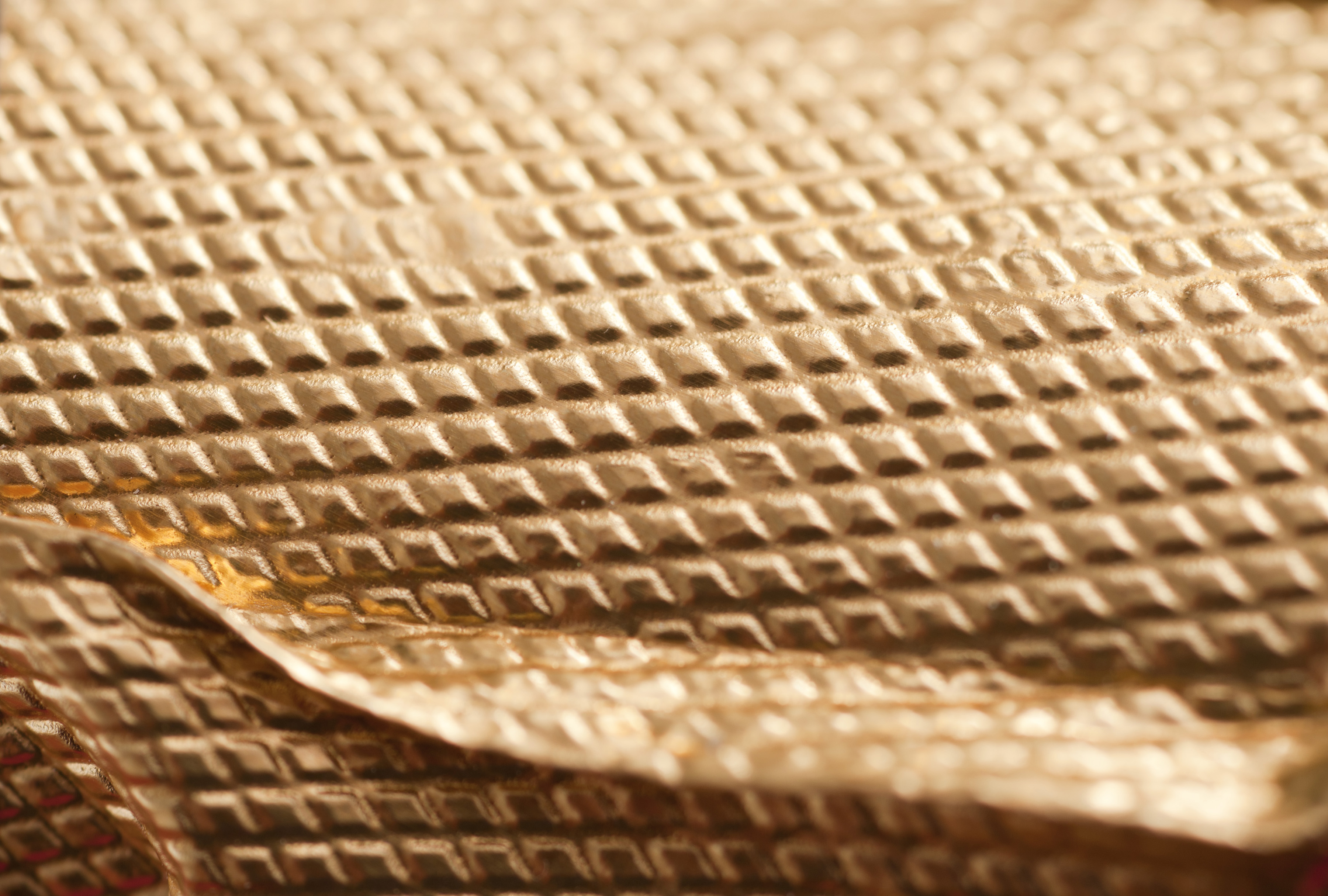 Extreme Close Up of Golden Textured Foil Wrapper from Champagne Bottle, Full Frame Background Image