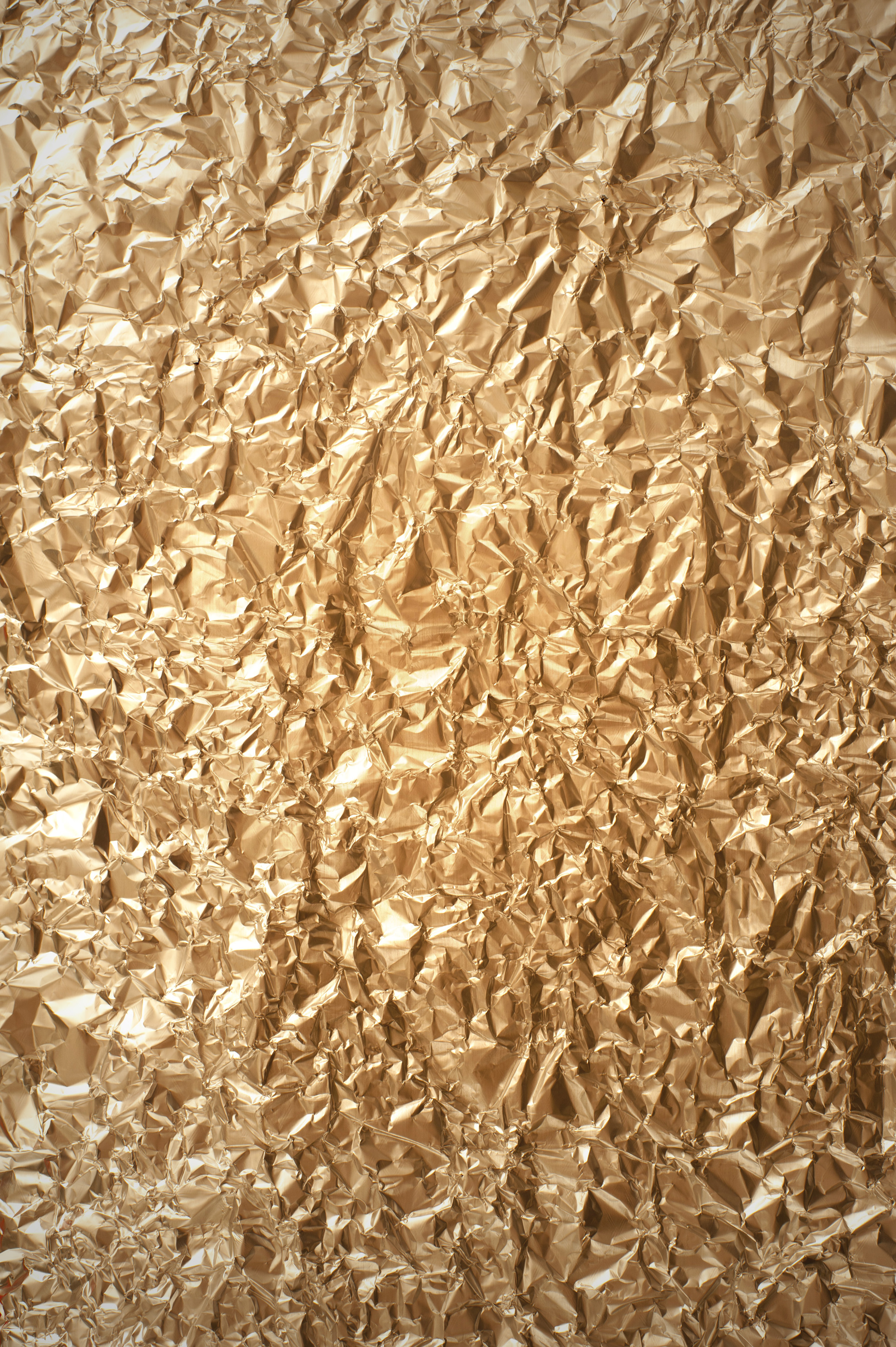 Full Frame of Crumpled Gold Foil, Abstract Background of Shiny Metallic Wrinkled Golden Paper