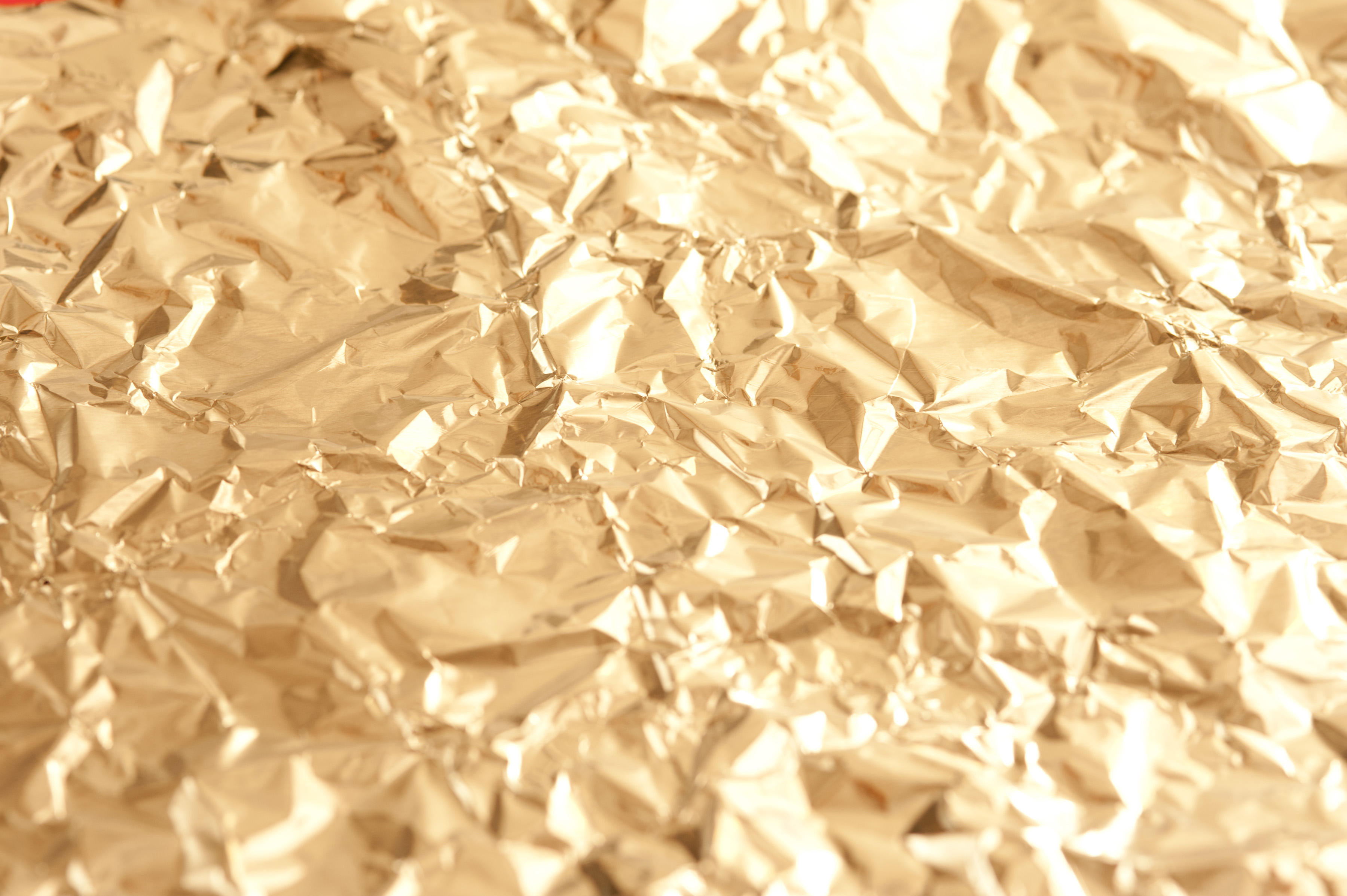 Full Frame Background Image of Luxurious and Festive Shining Golden Crinkled Foil