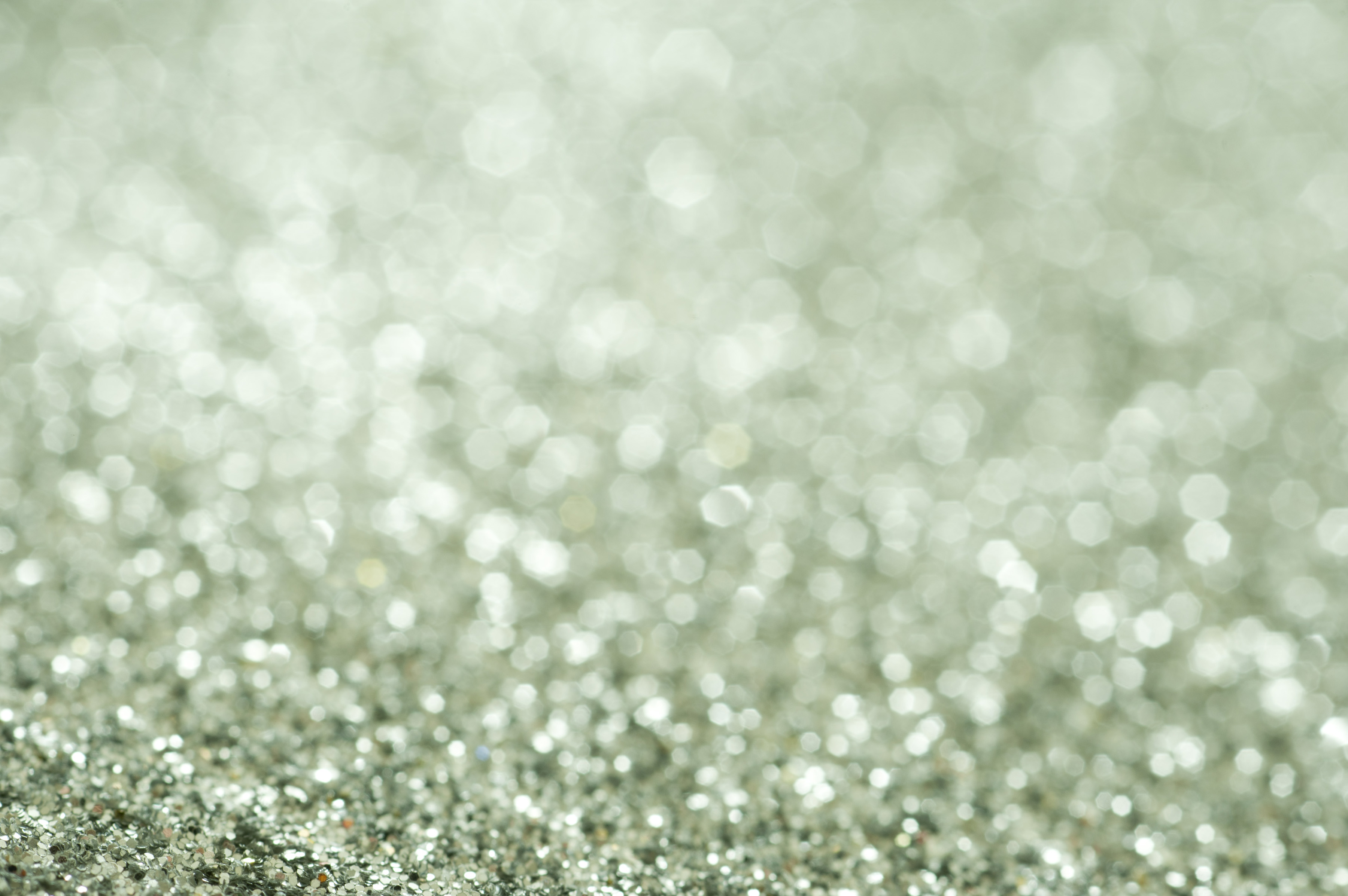 Green glitter background texture with shallow DOF and copy space for your Christmas or festive greeting, full frame