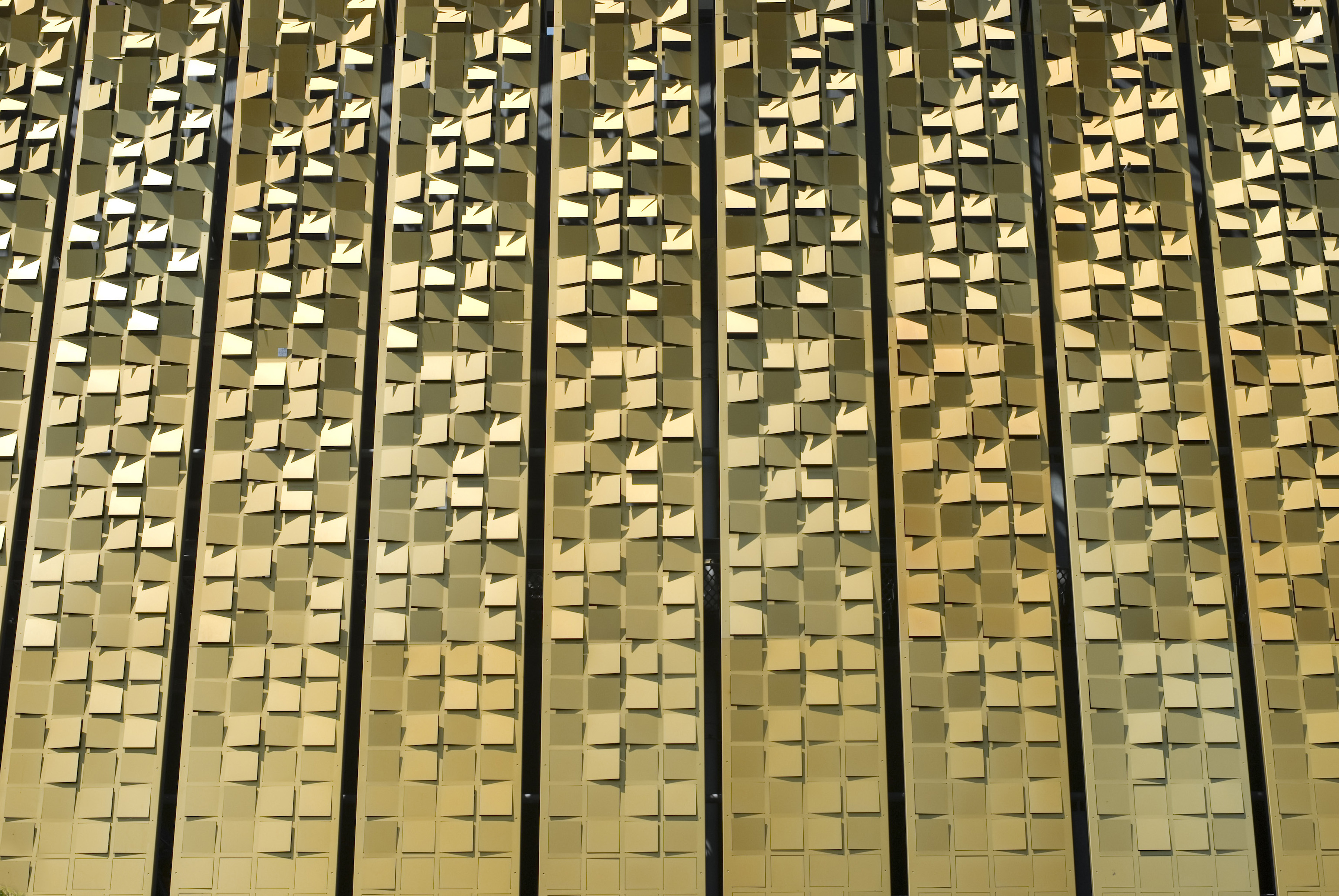 Architecutral metal cladding in a gold colour creates an interesting texture or backdrop