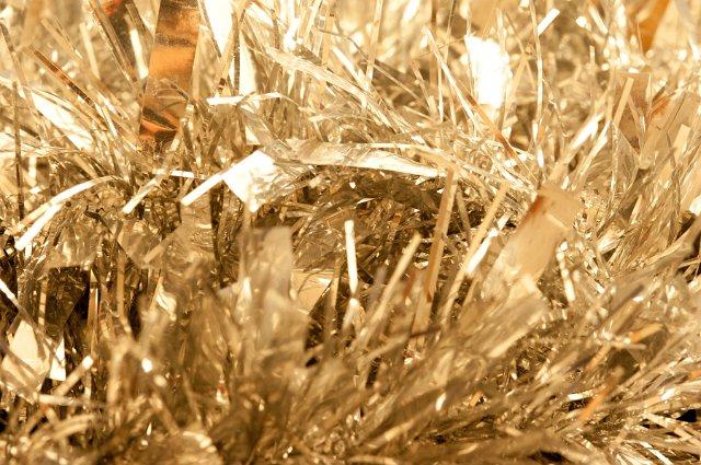 close up of gold tinsel garland