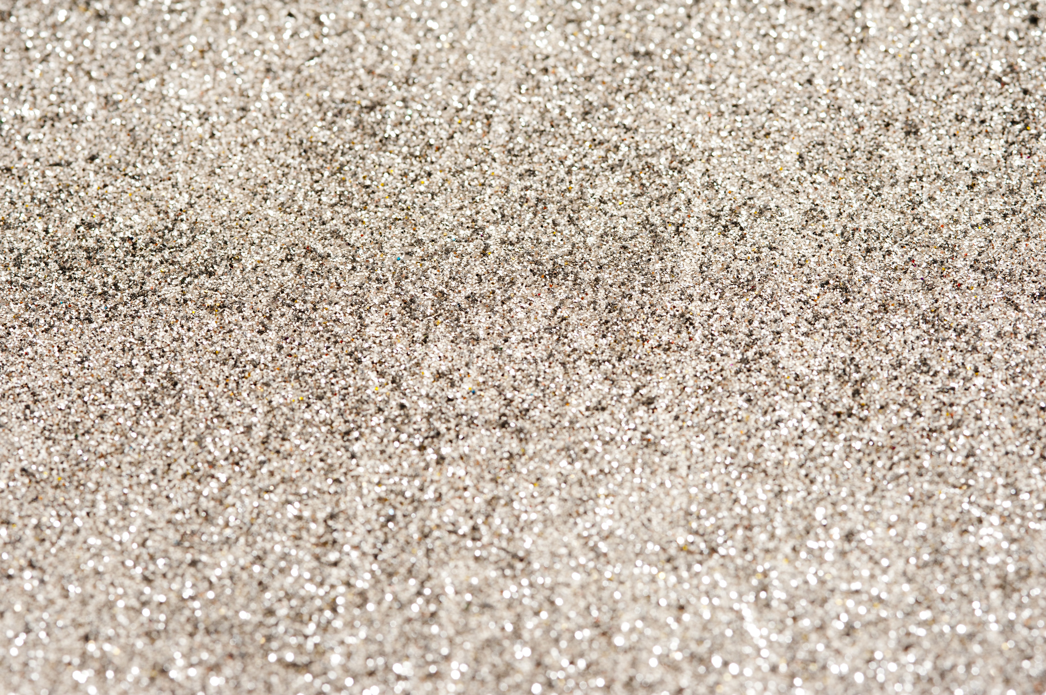 Full frame silver glitter festive background texture for a Christmas themed concept
