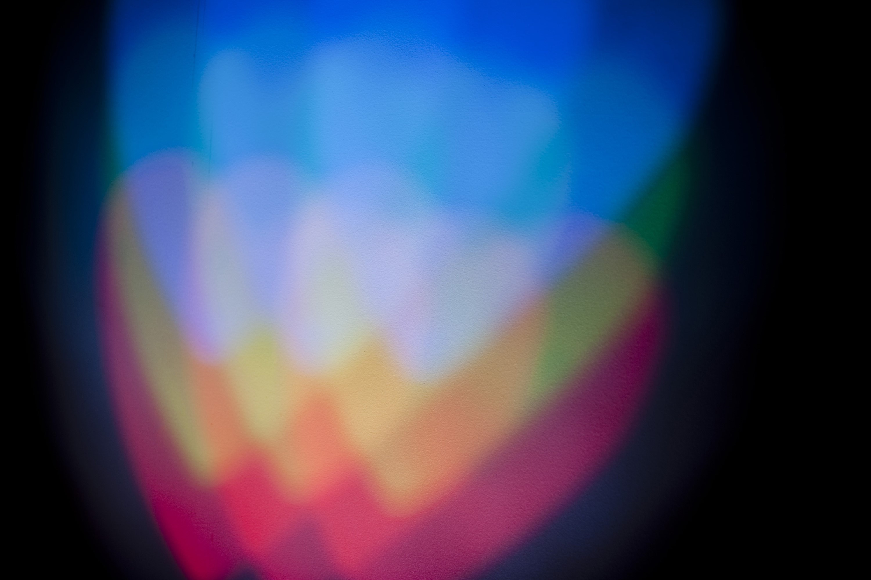 colorful overlapping light hearts with a grain texture