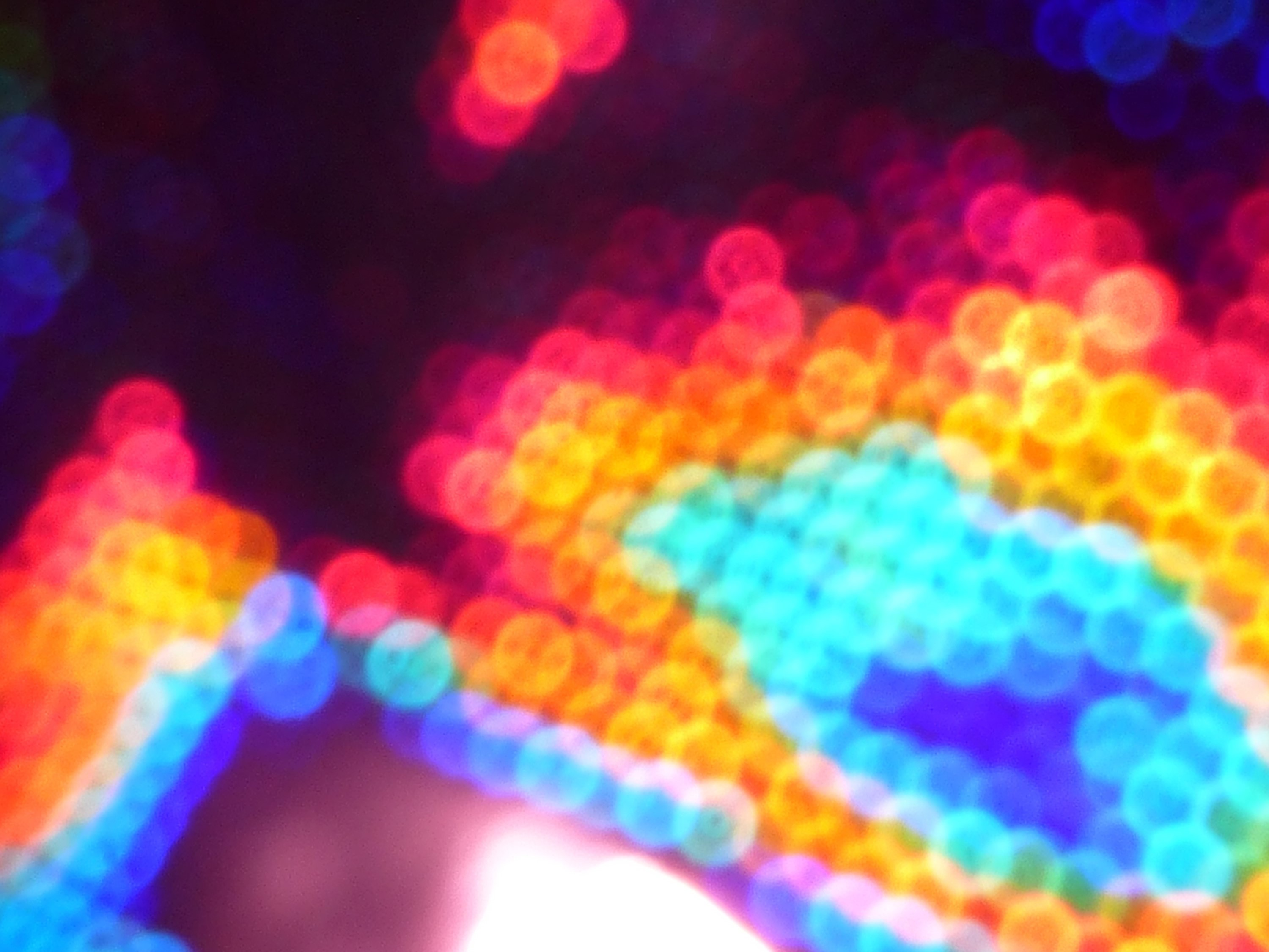 colorful background composed of diffuse overlapping bokeh circles in various bright colours