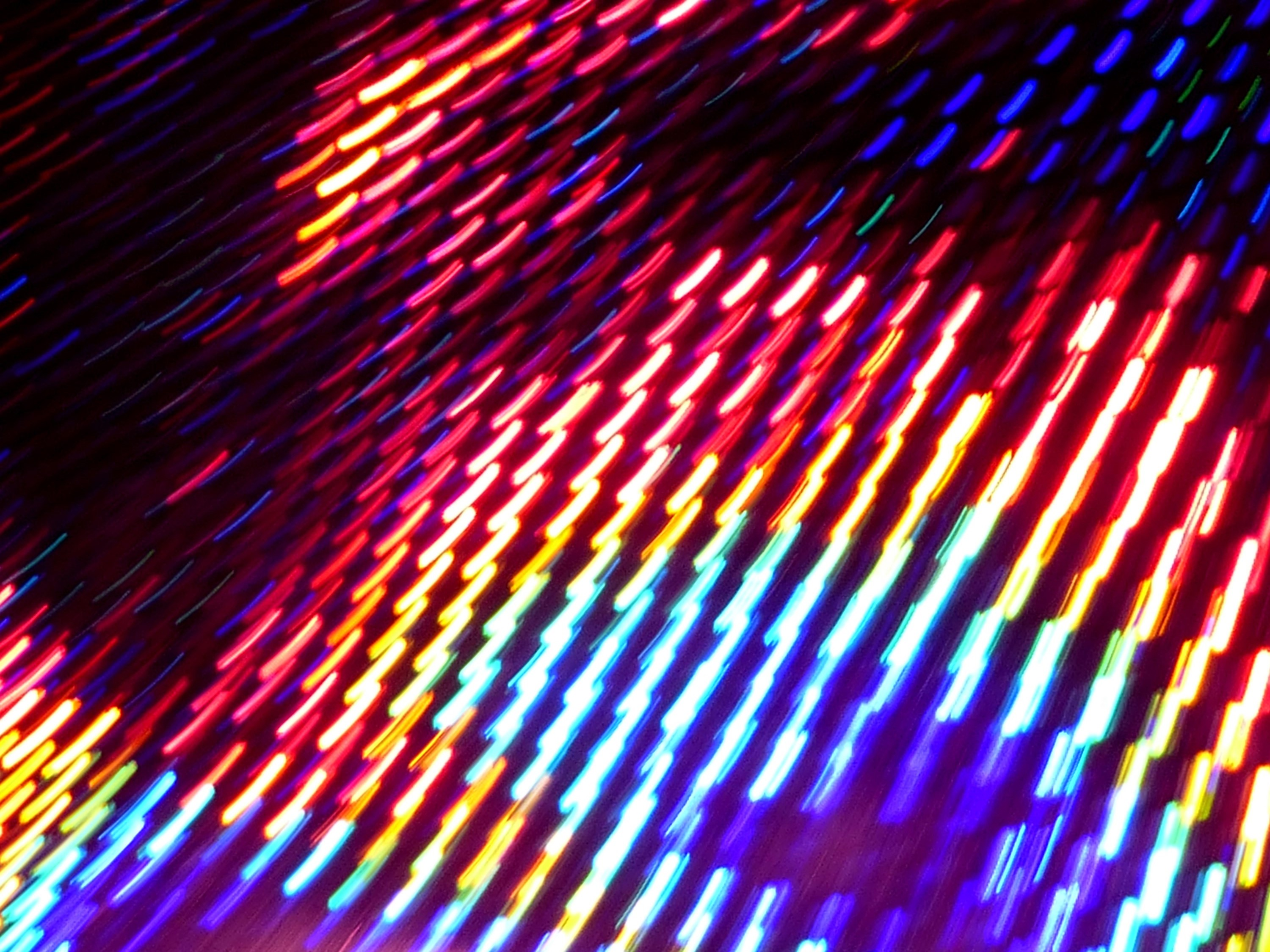 glowing strikes of light formed into a matrix array of colours