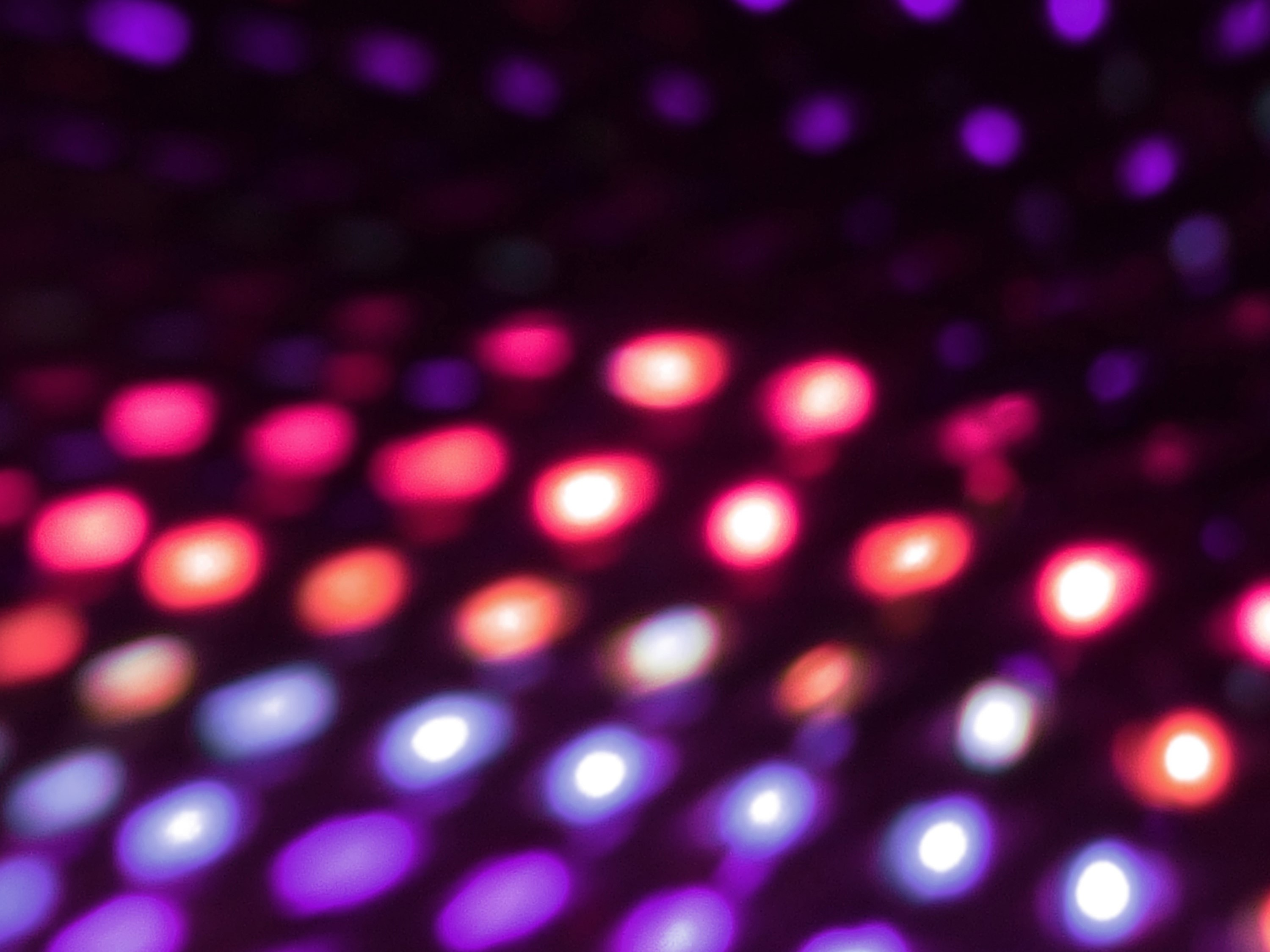 a colorful red and purple matrix of lights on black