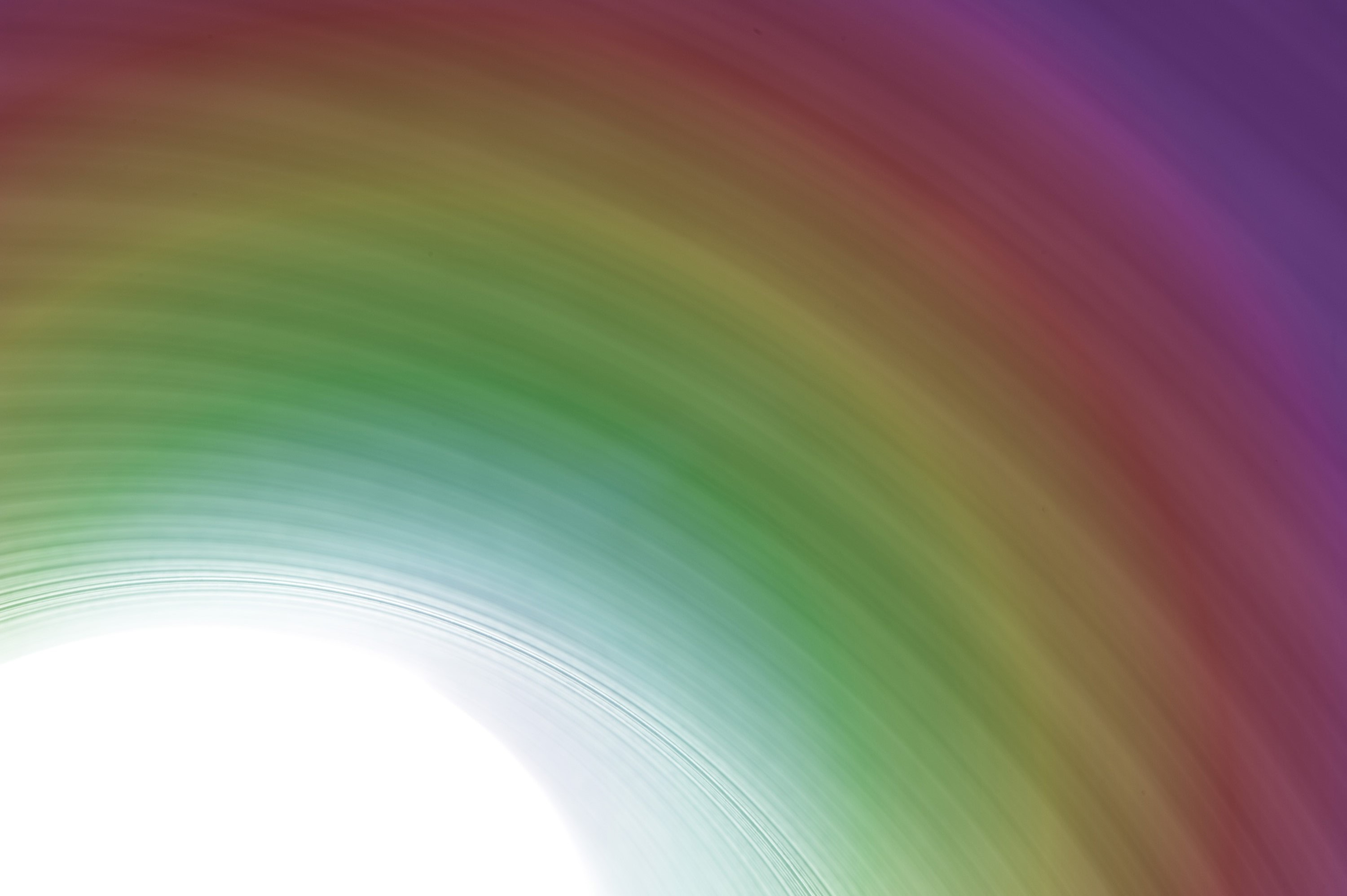bright white light with colorful rainbow lines emanating from the centre