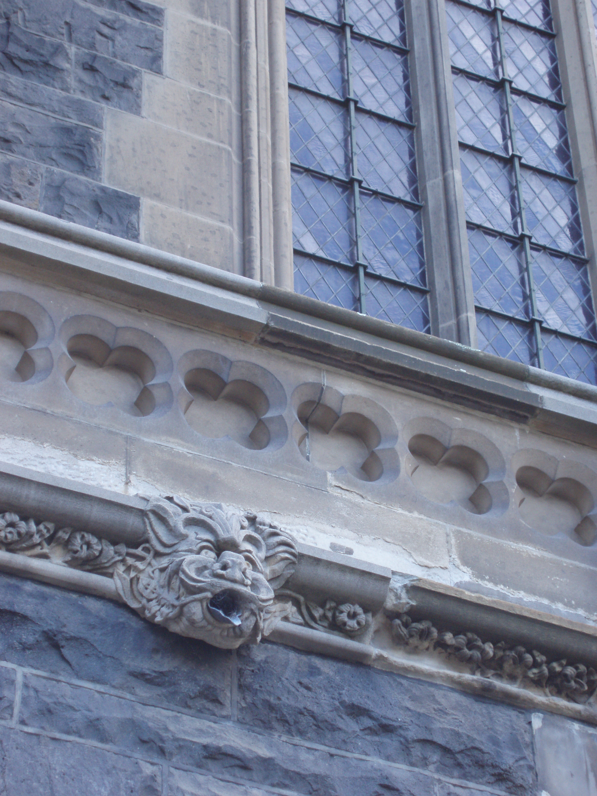 church details, a gargoyle with led pipe mouth