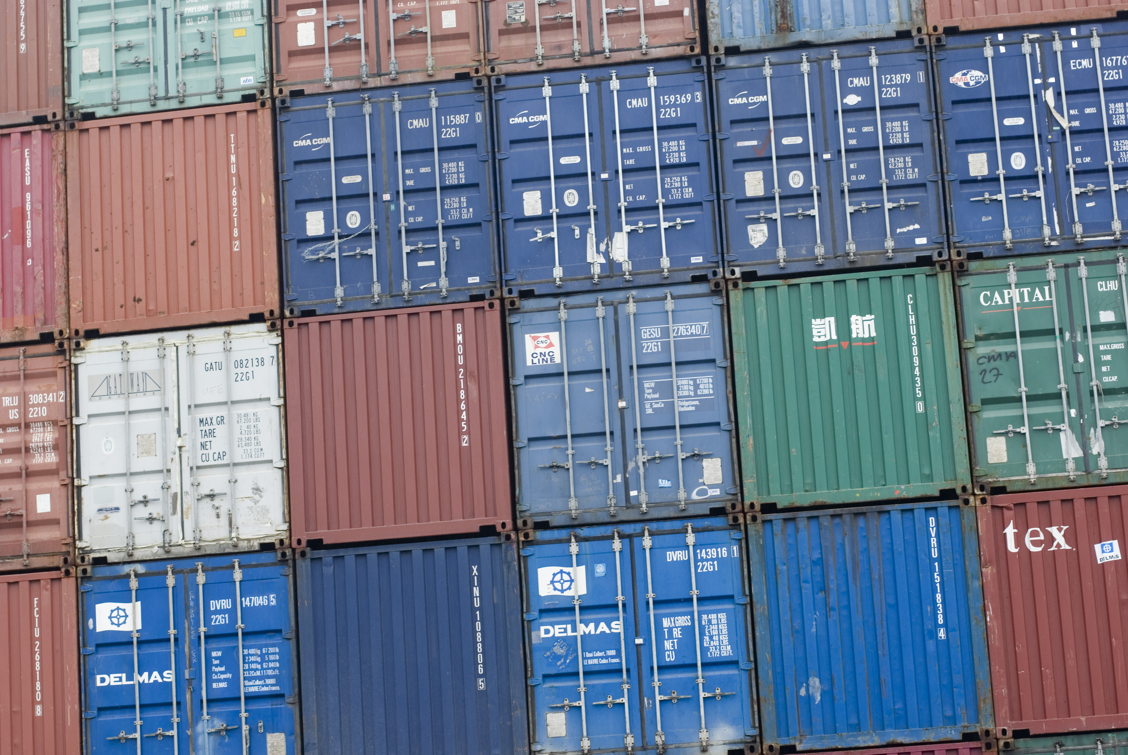 a stack of shipping containers at a cargo terminal