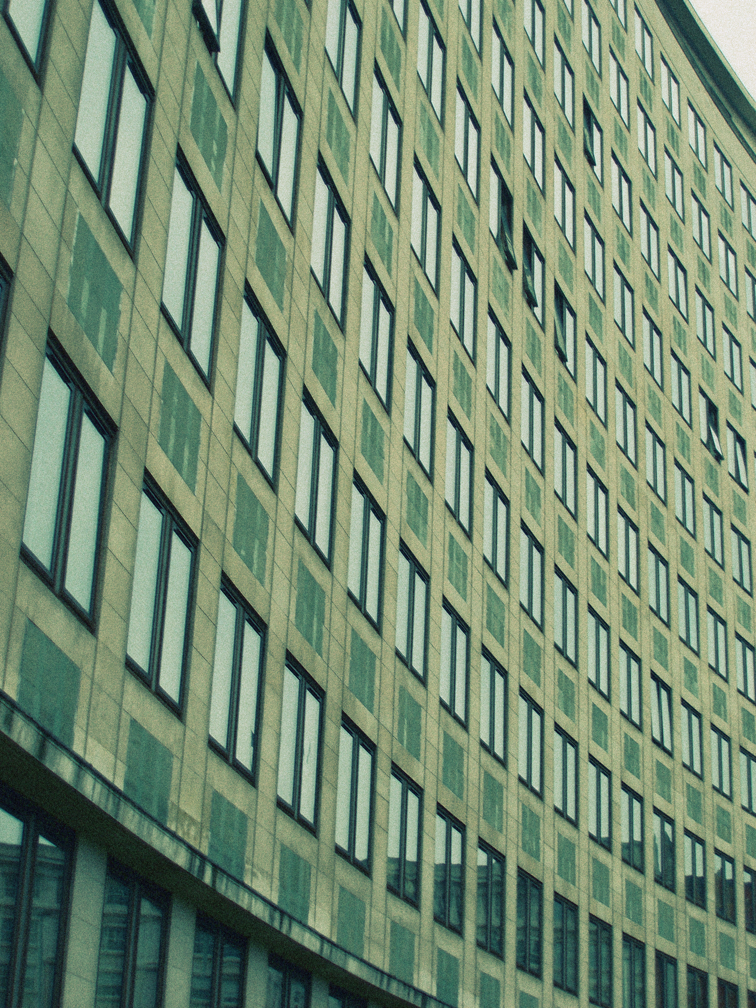 tower block facade grainy cross processed effect