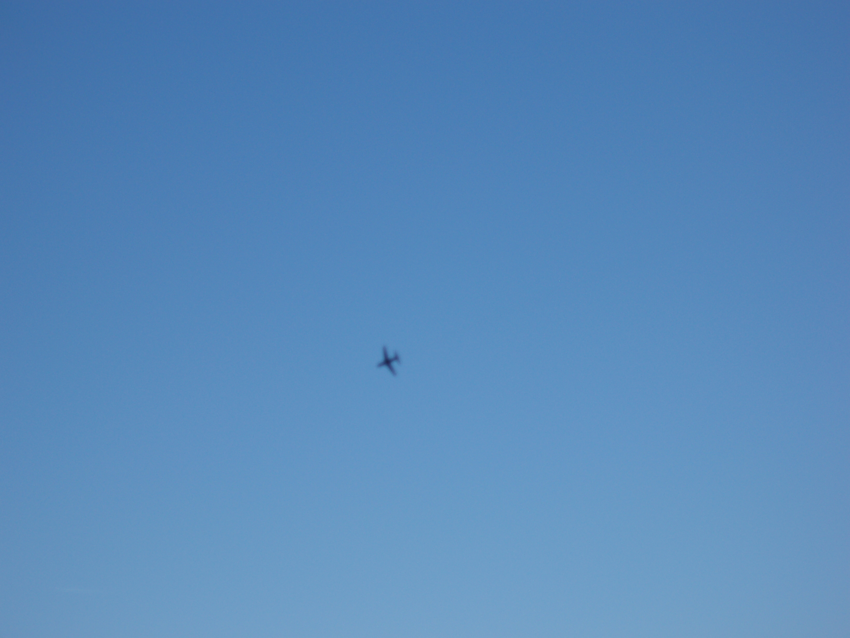 abstract sky image, small defocussed plane shape