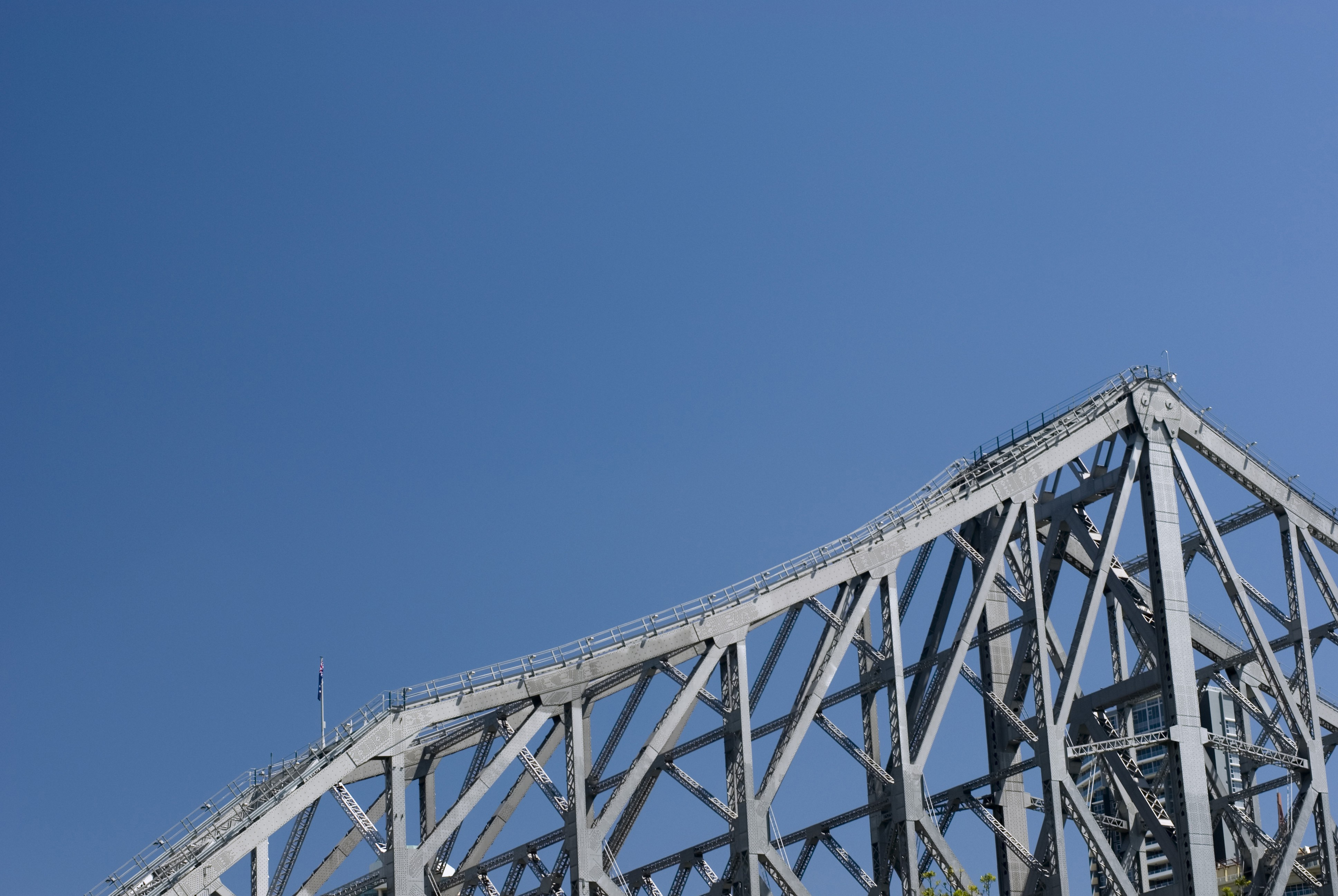 the superstructure of a large metal road bridge, story bridge, brisbane, australia