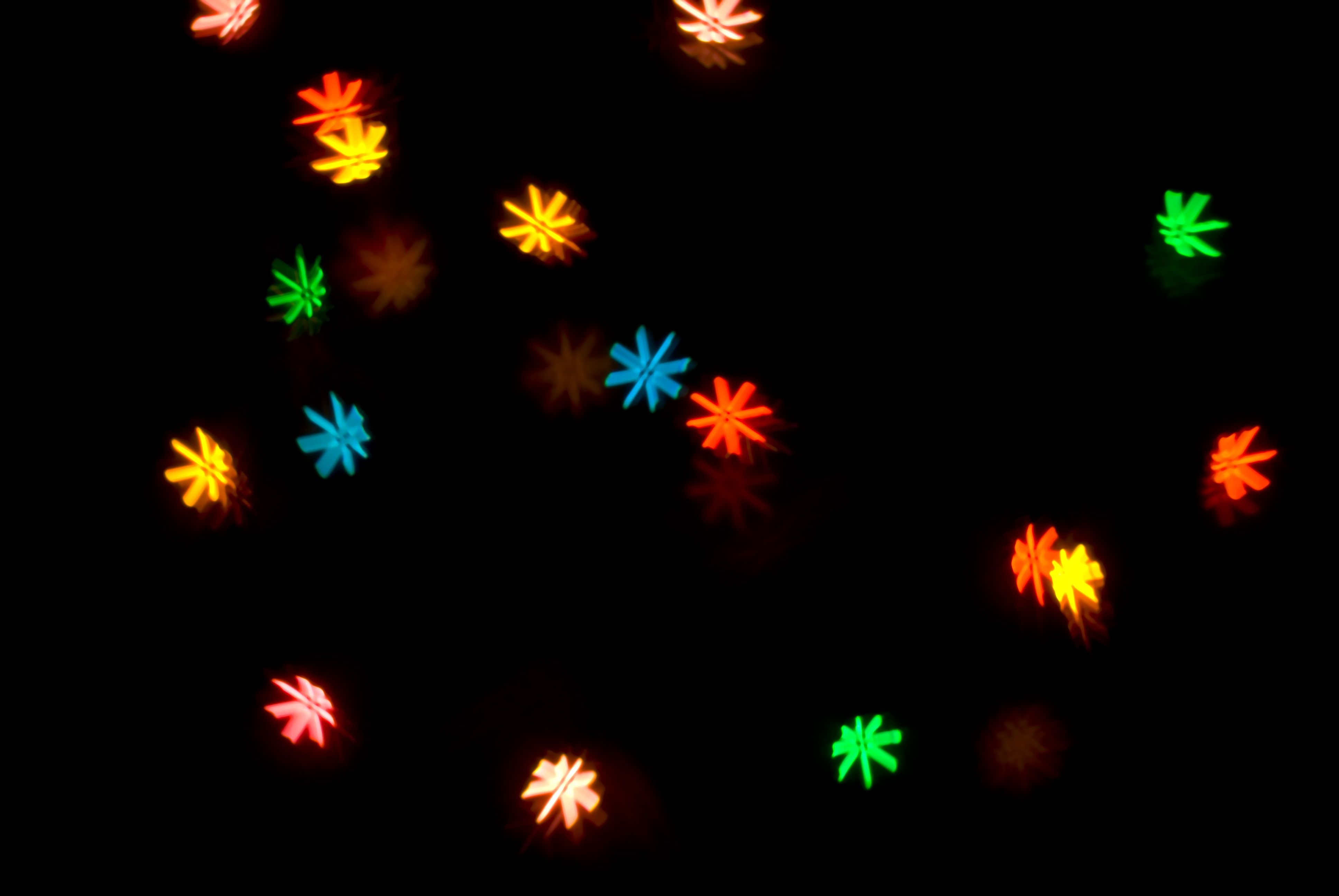 a pattern of colourful bokeh shapes