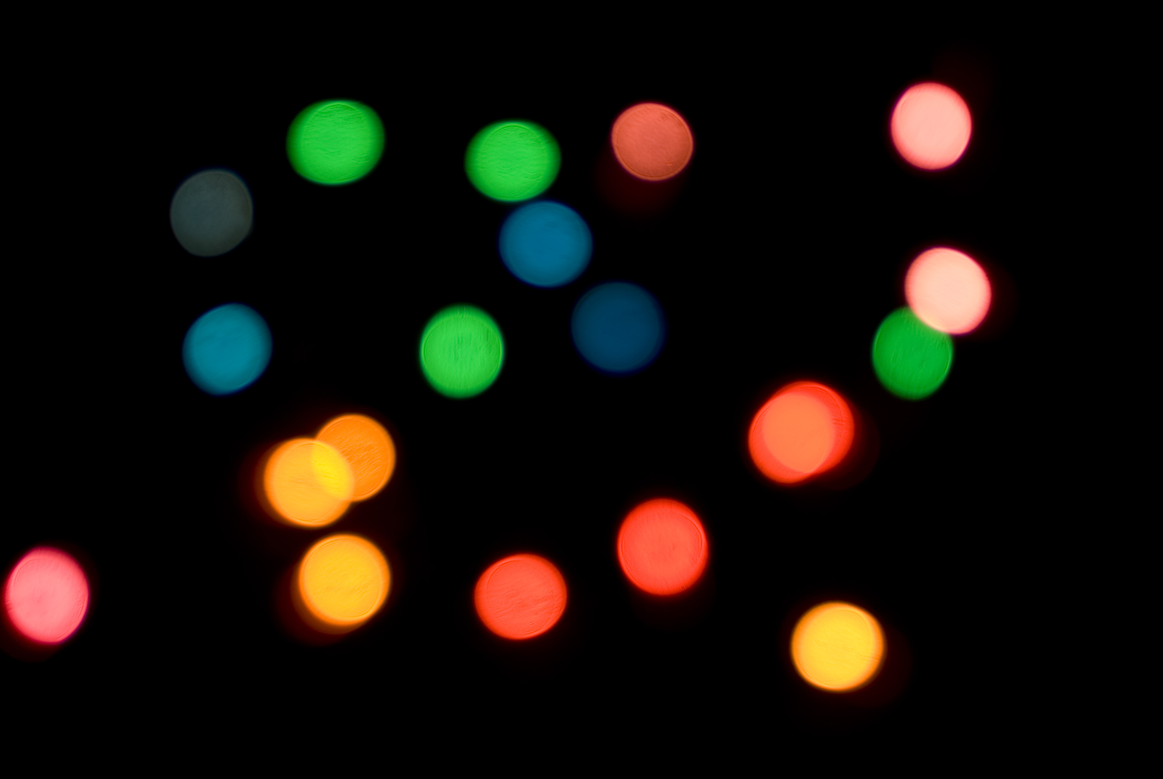 a background of coloured bokeh light circles