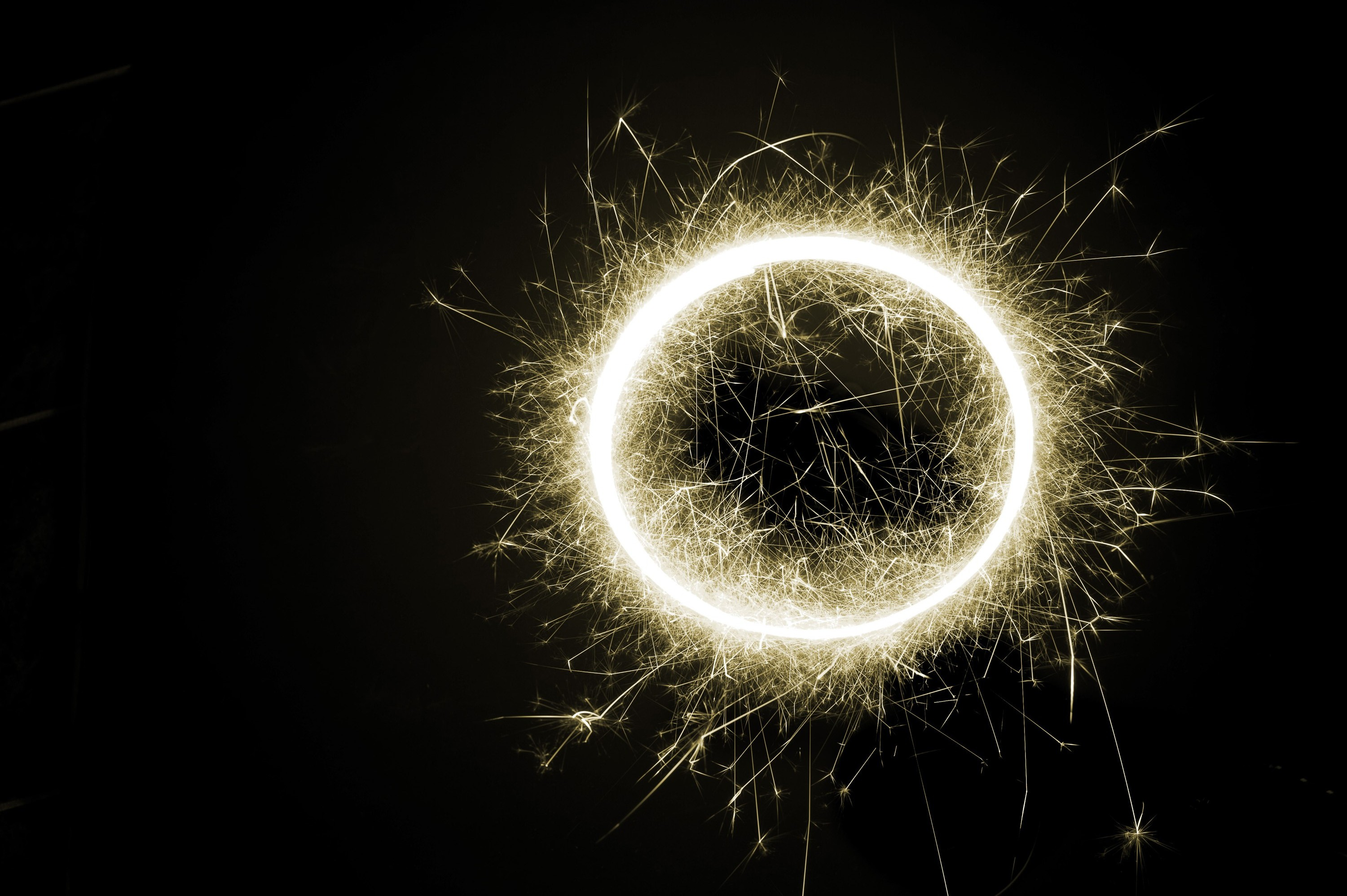 a circle of light surrounded by sparks
