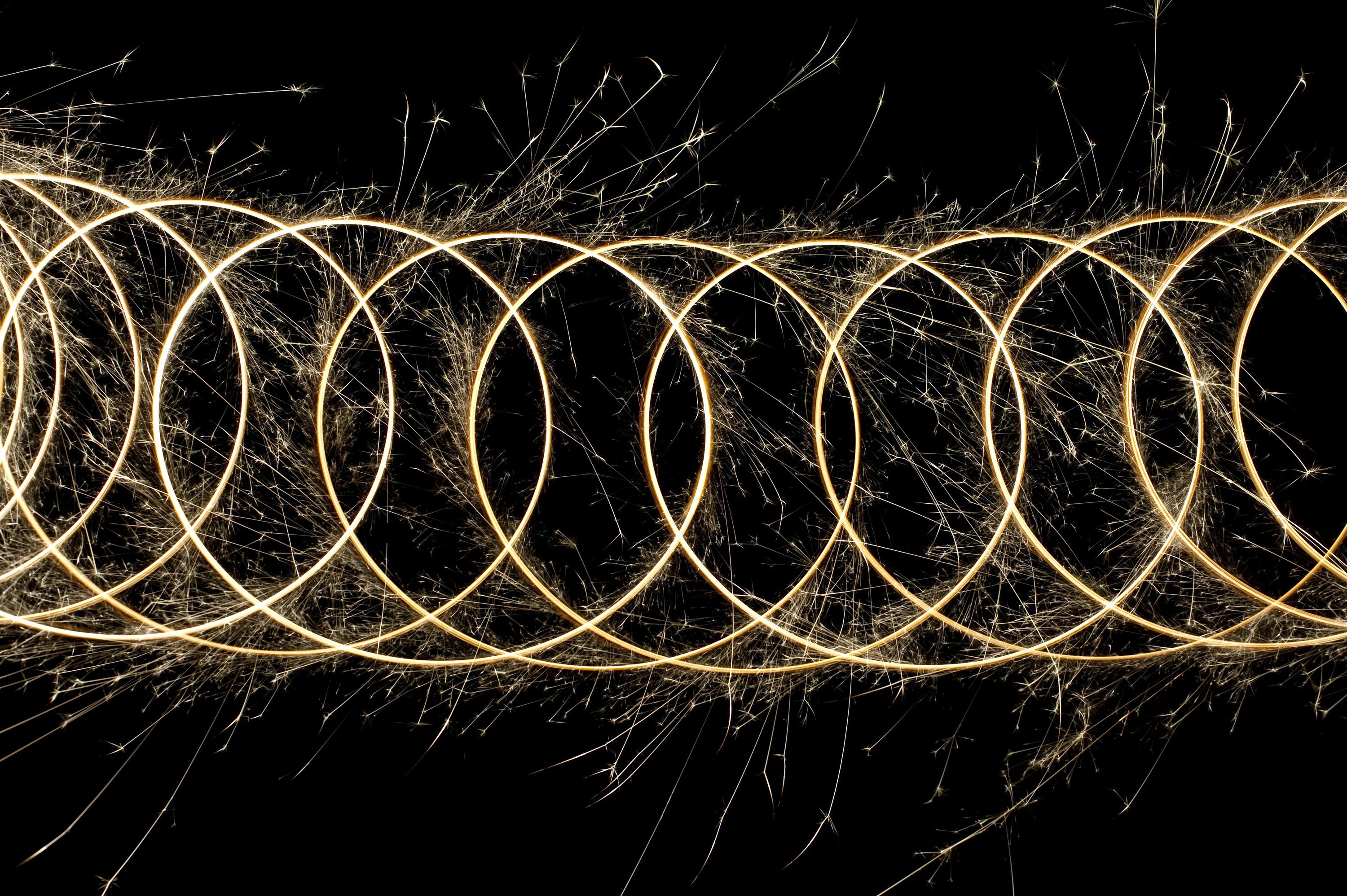 a bright pattern of sparks tracing a looping formation