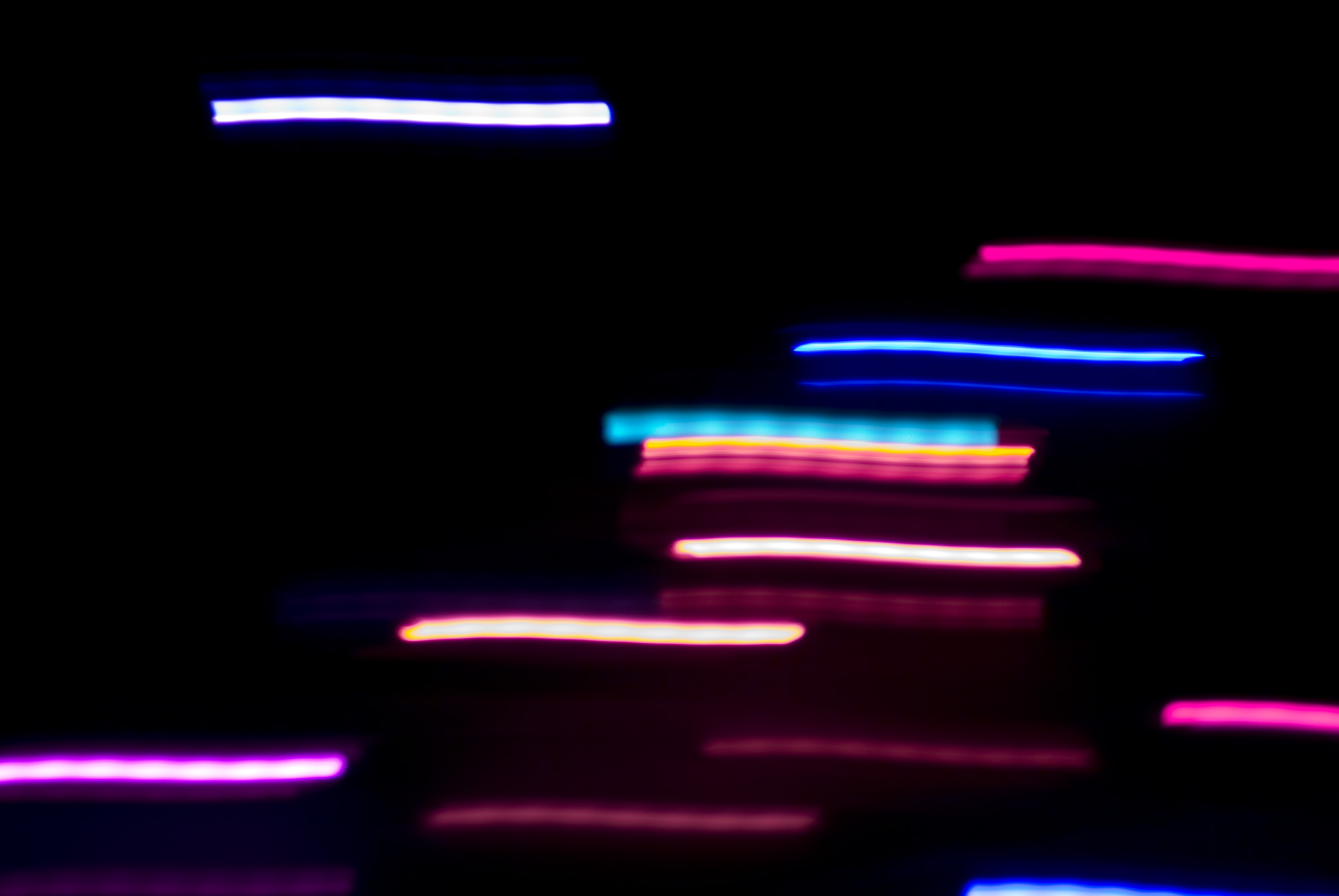 blurred motion trails, a long exposure of some moving coloured light
