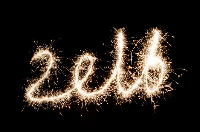 sparkling trails of light drawing out the numbers 2016 in glowing light to welcome in the new year