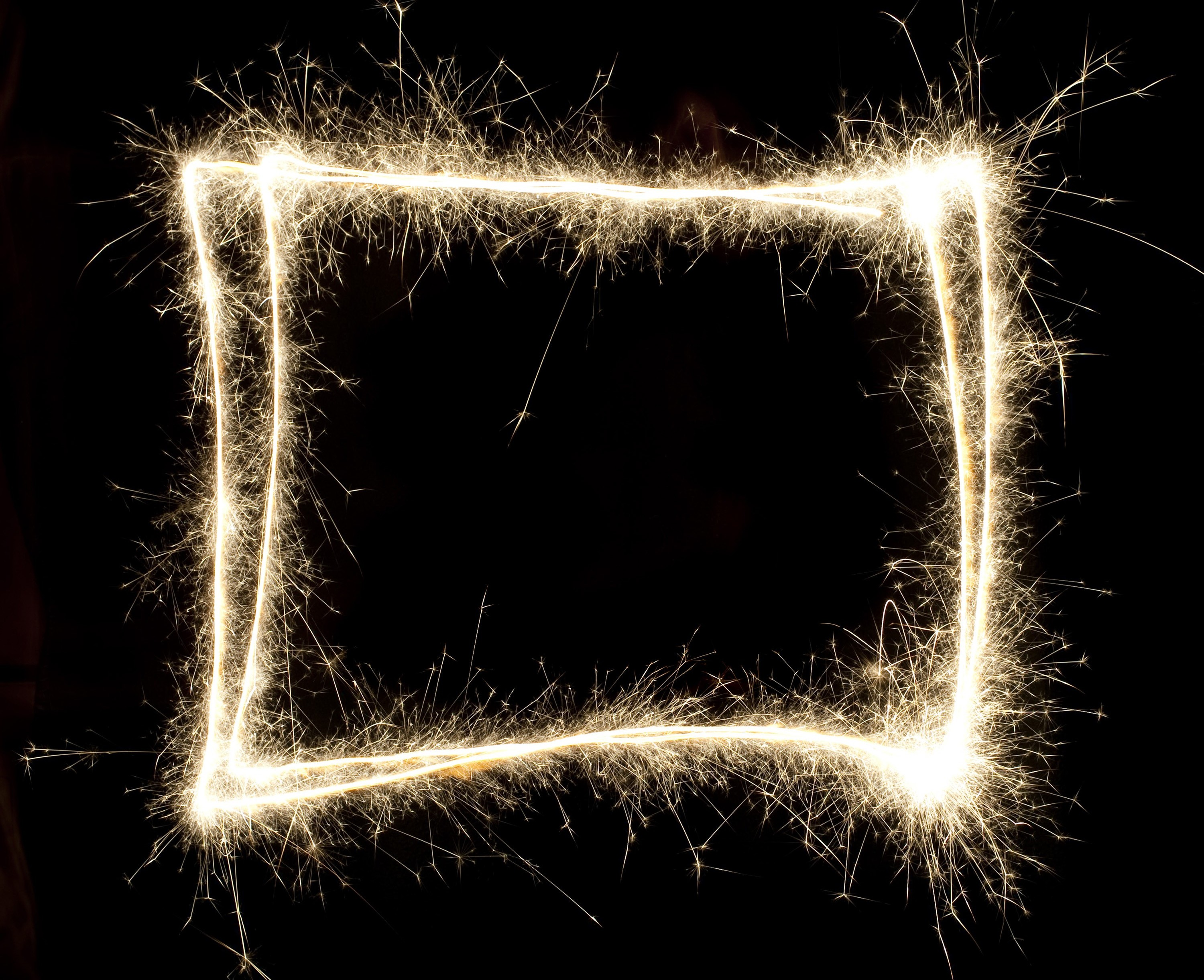 a rectangular frame of glowing sparks