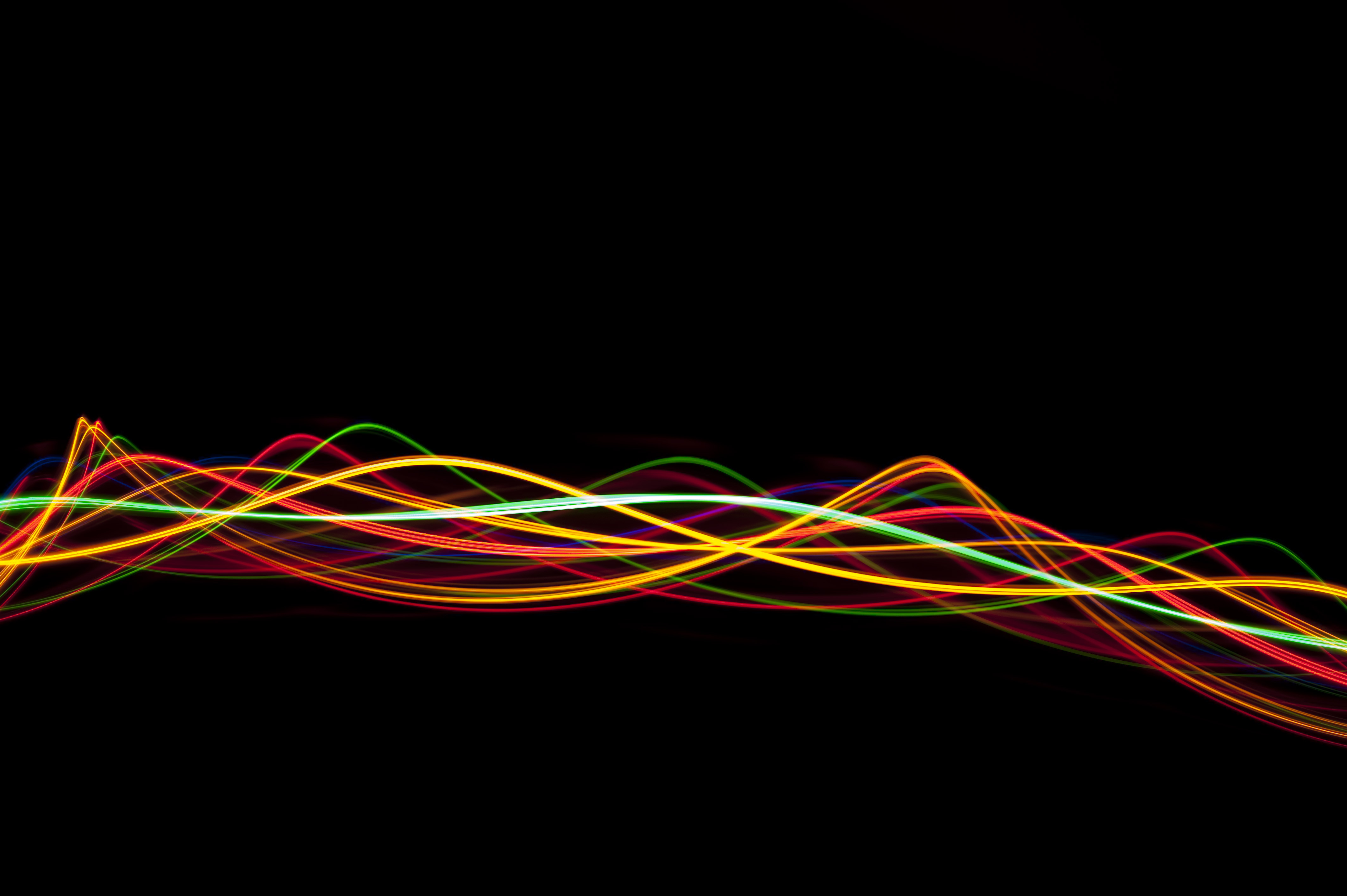 a bundle of twisting lines of colored light