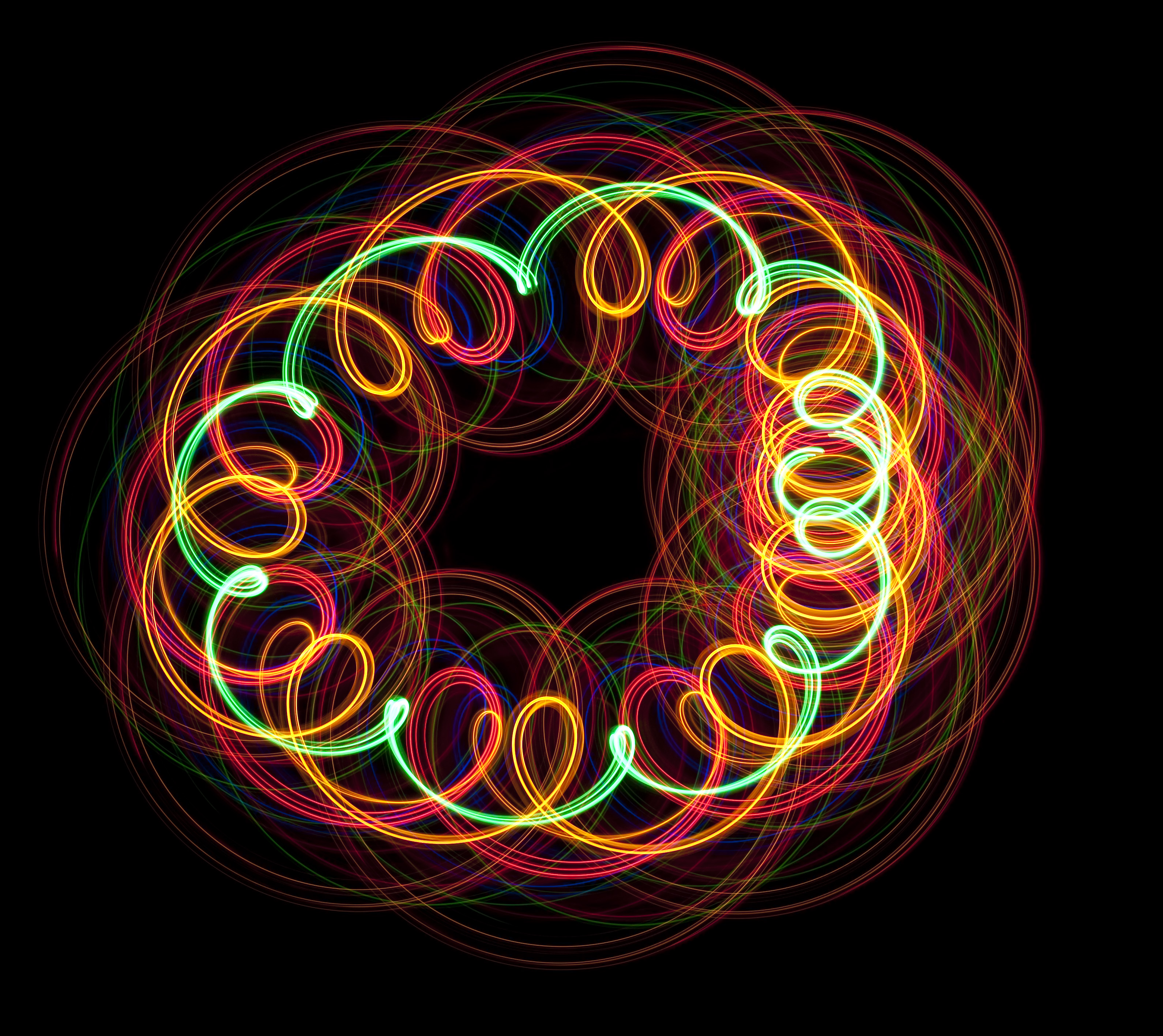 red green and orange lights spiraling round to form a circular pattern