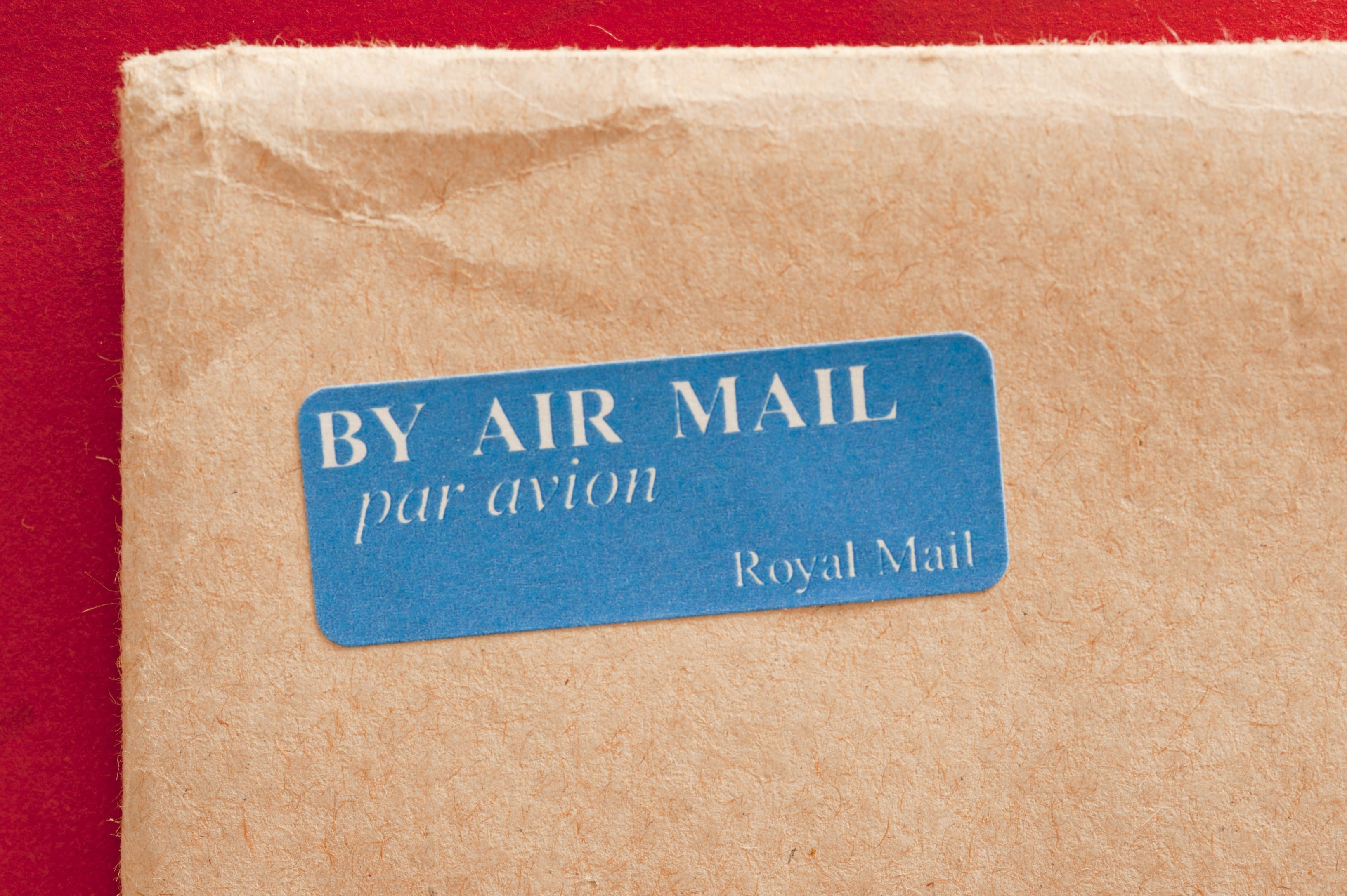 brown envelope with an air mail sticker on it