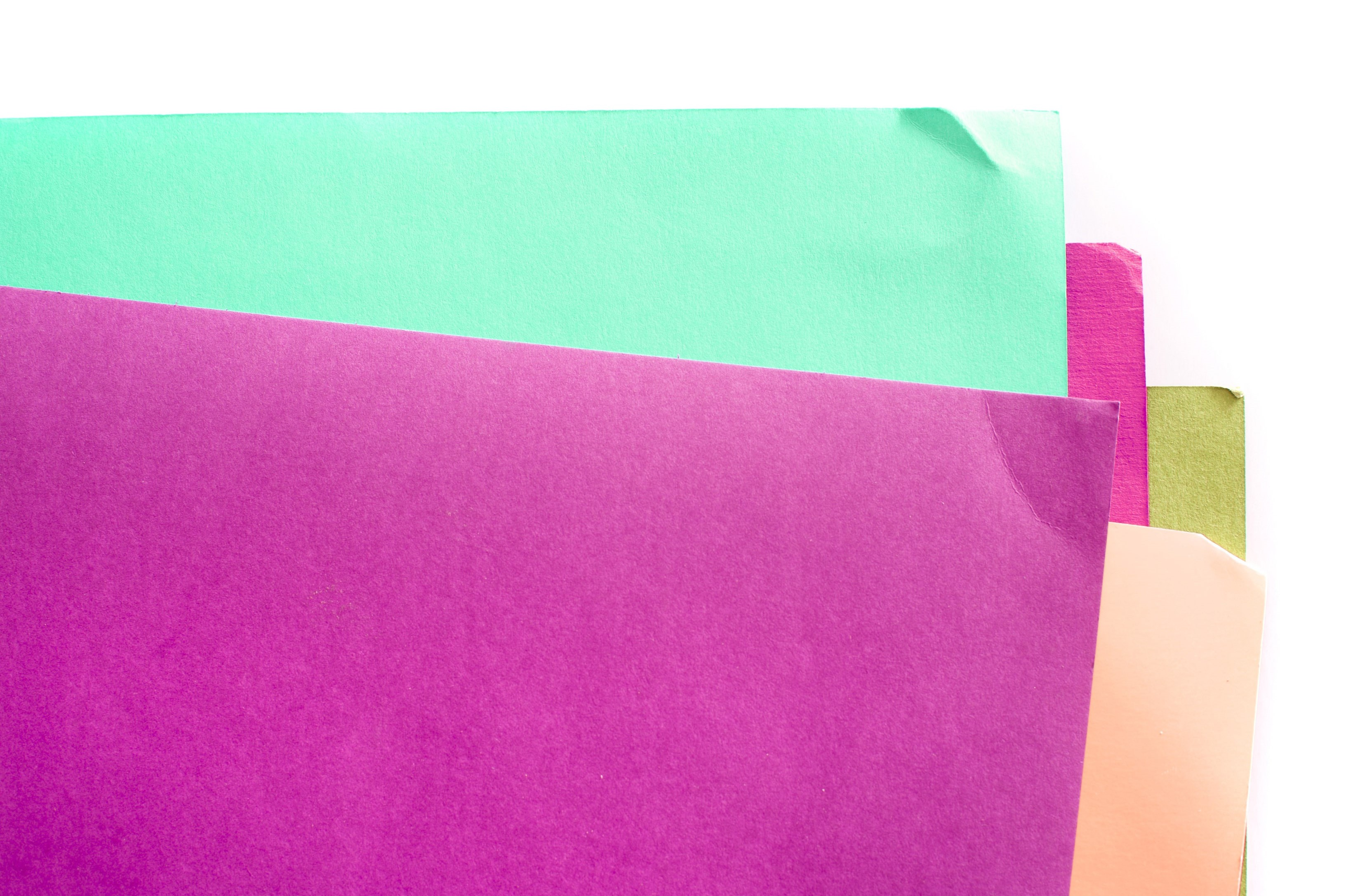A series of overlapped sheets of colourful paper