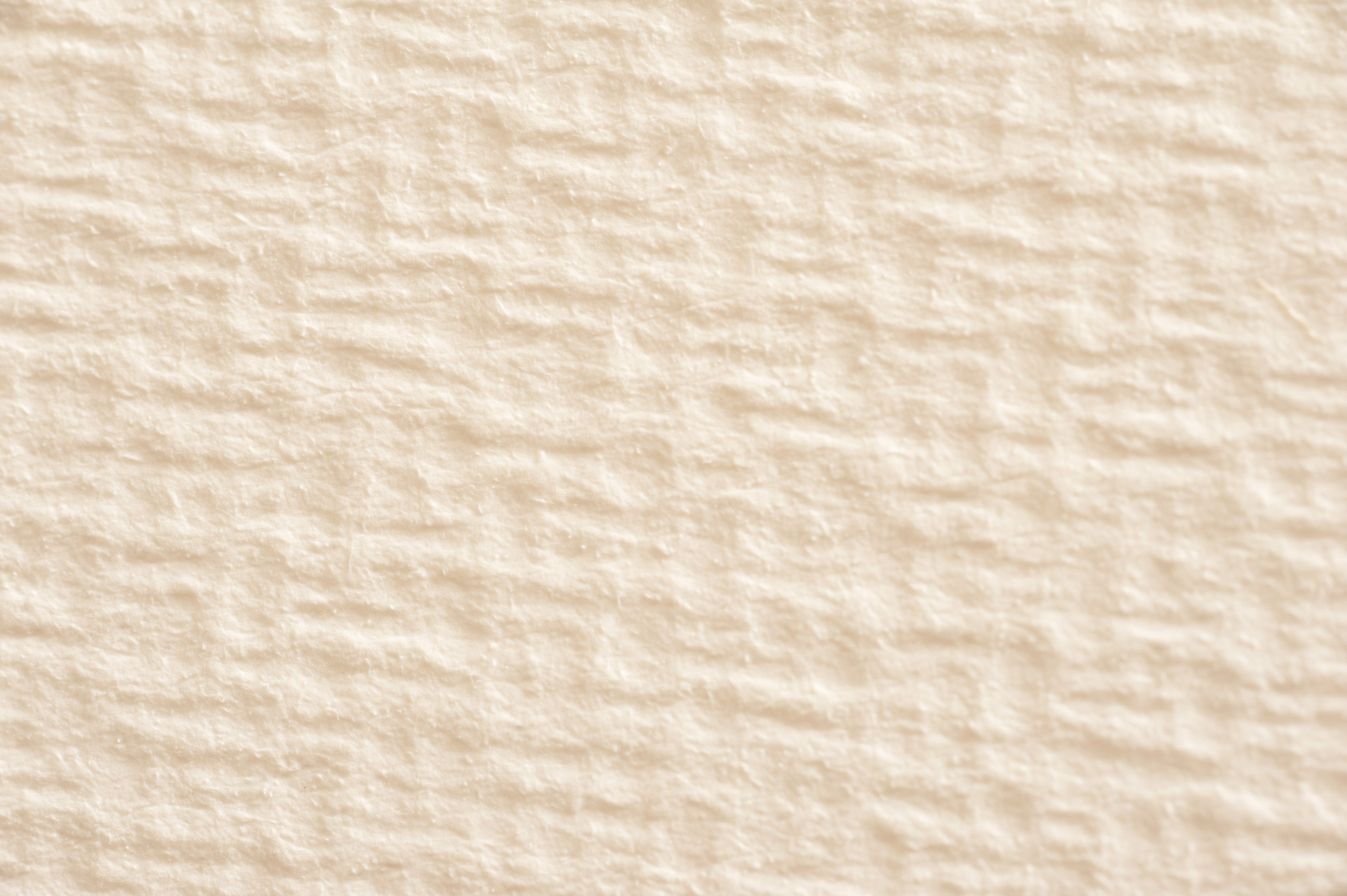 rough paper surface texture in a cream colour