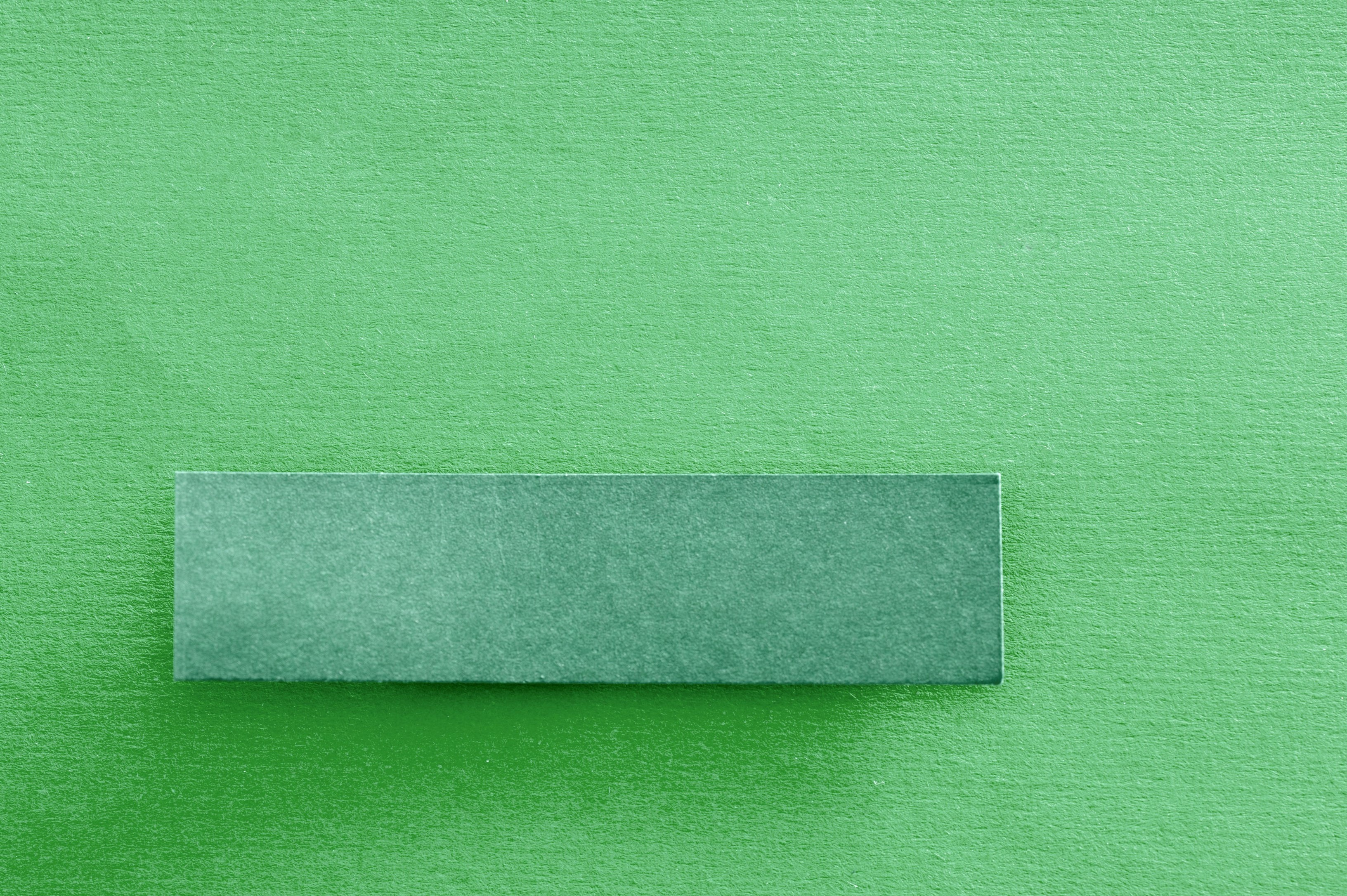 a green textured paper label on green background