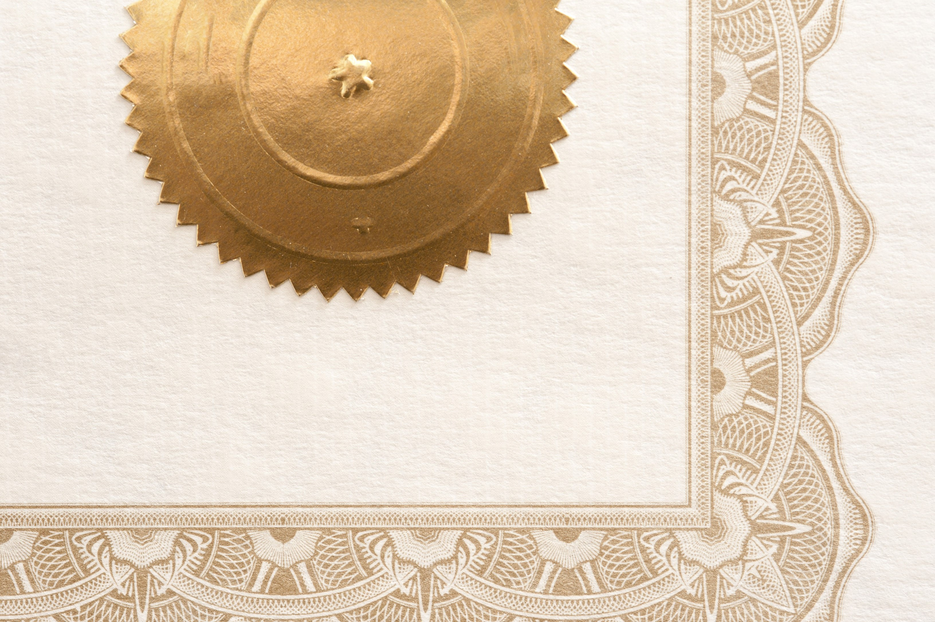 a certificate border and gold stamp sticker