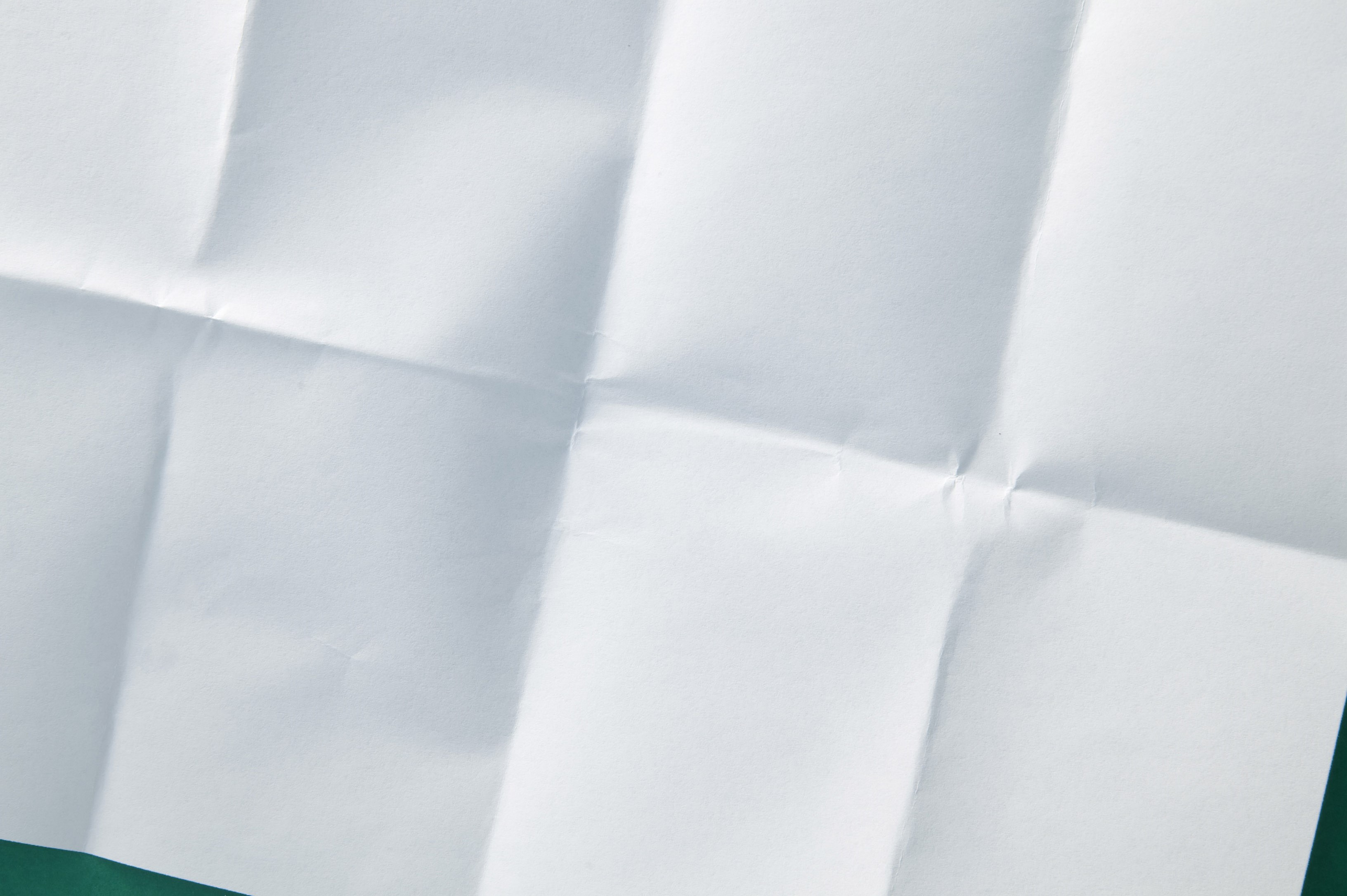 a sheet of paper folder into 8 and unfolded again at an angle
