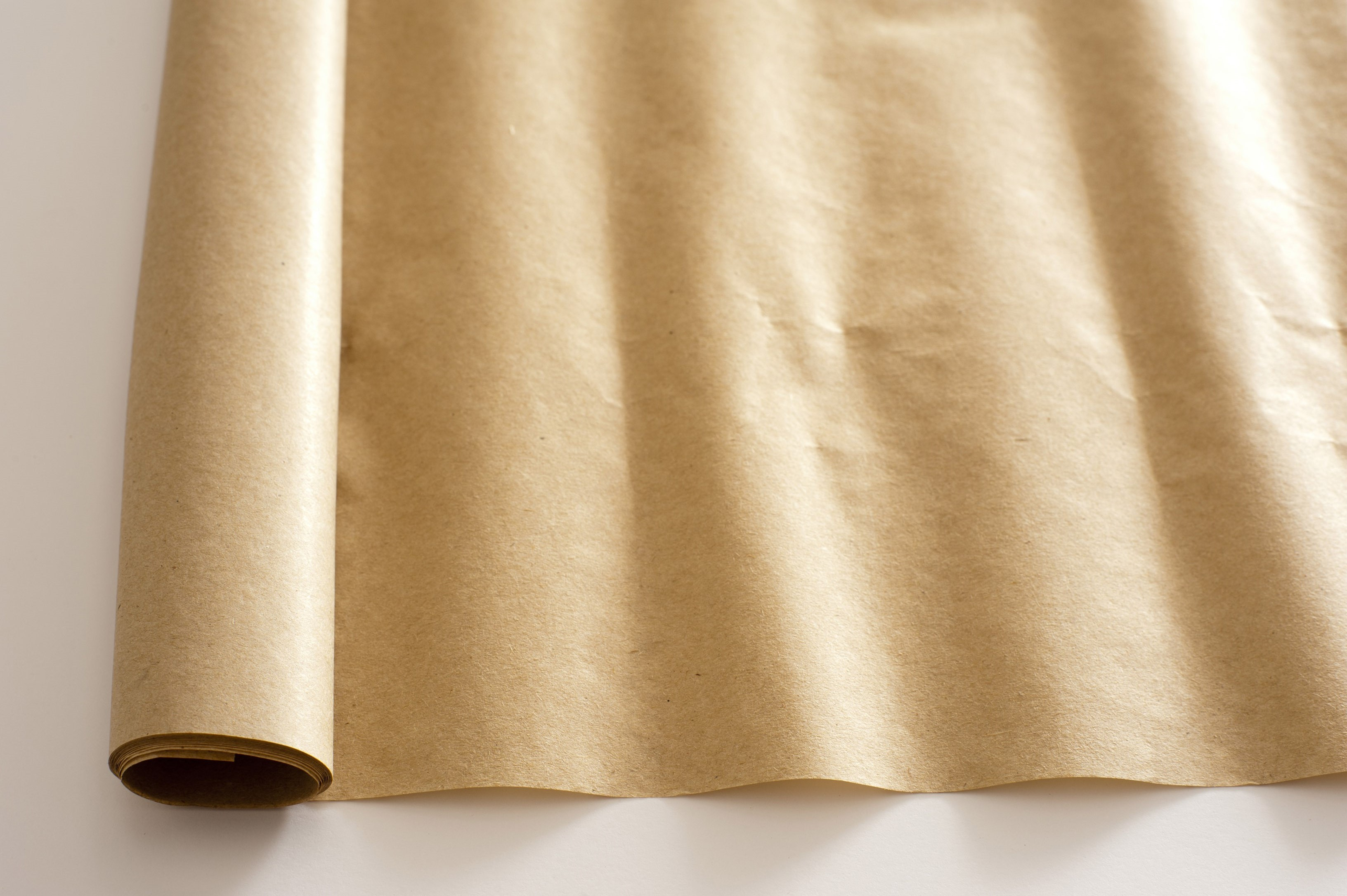 an unrolled piece of brown packaging paper