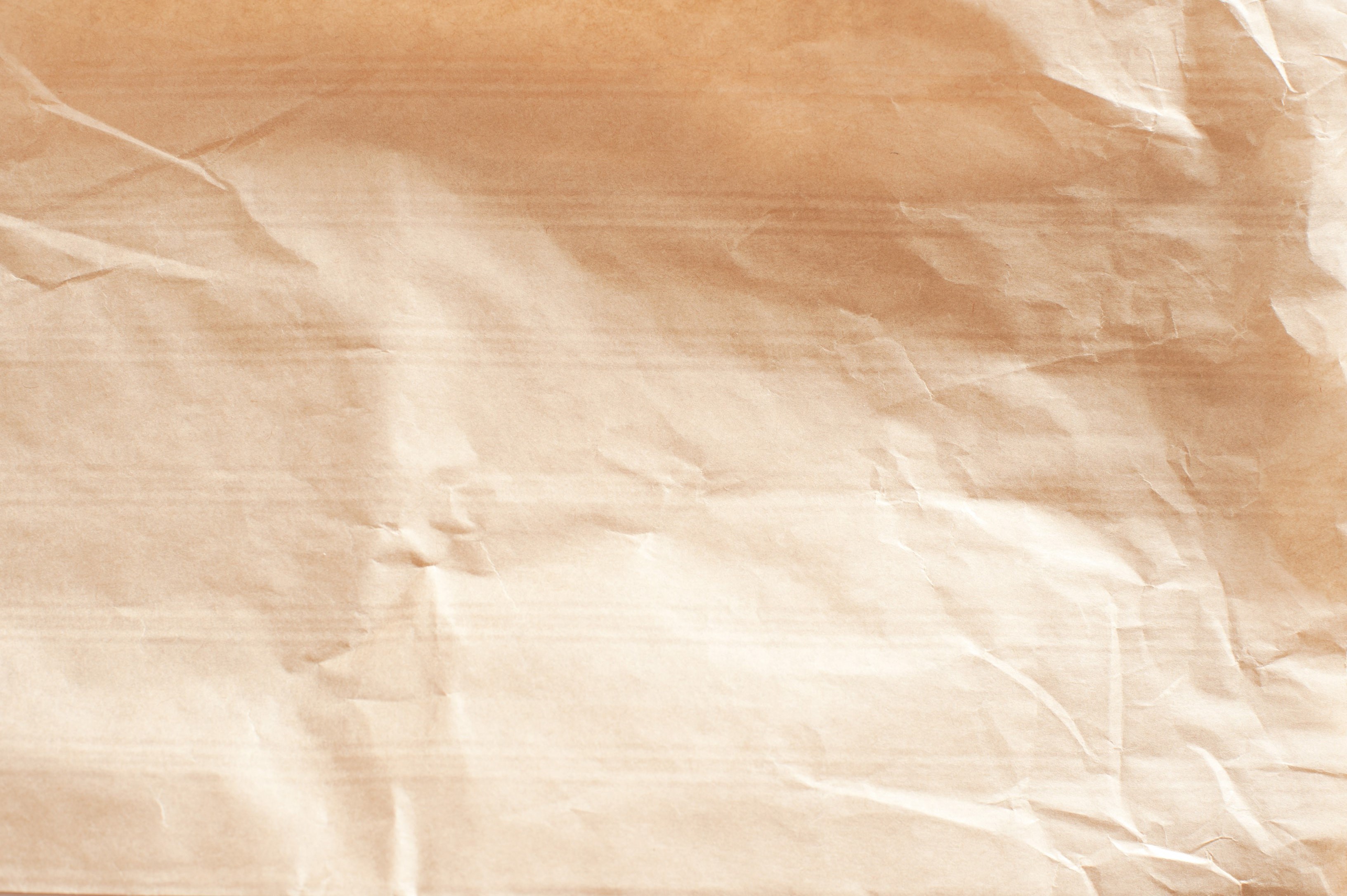 creased and crumpled brown paper surface with horizontal ribs