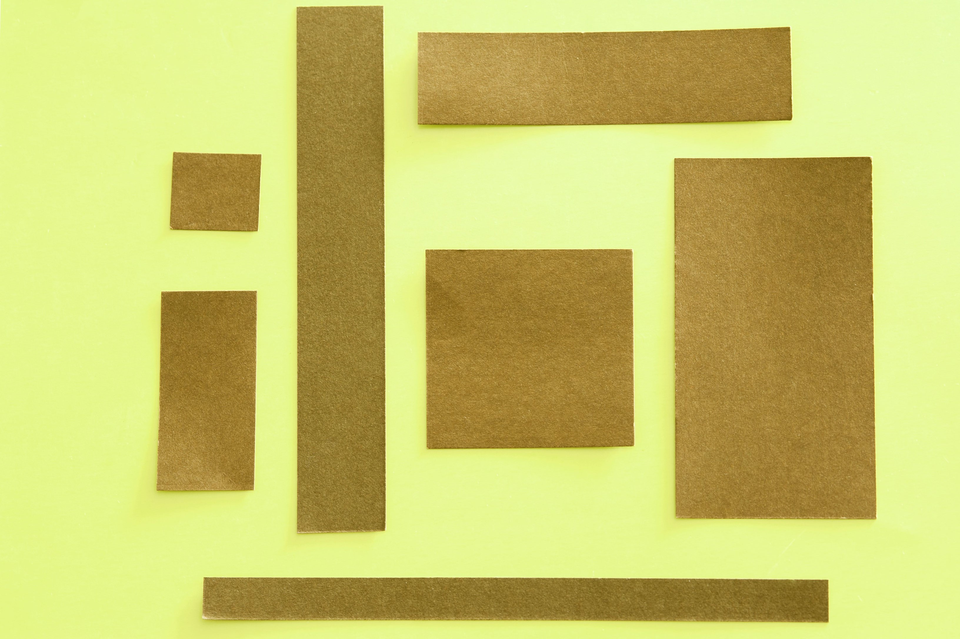 squares of craft paper on a yellow background with spaces for text