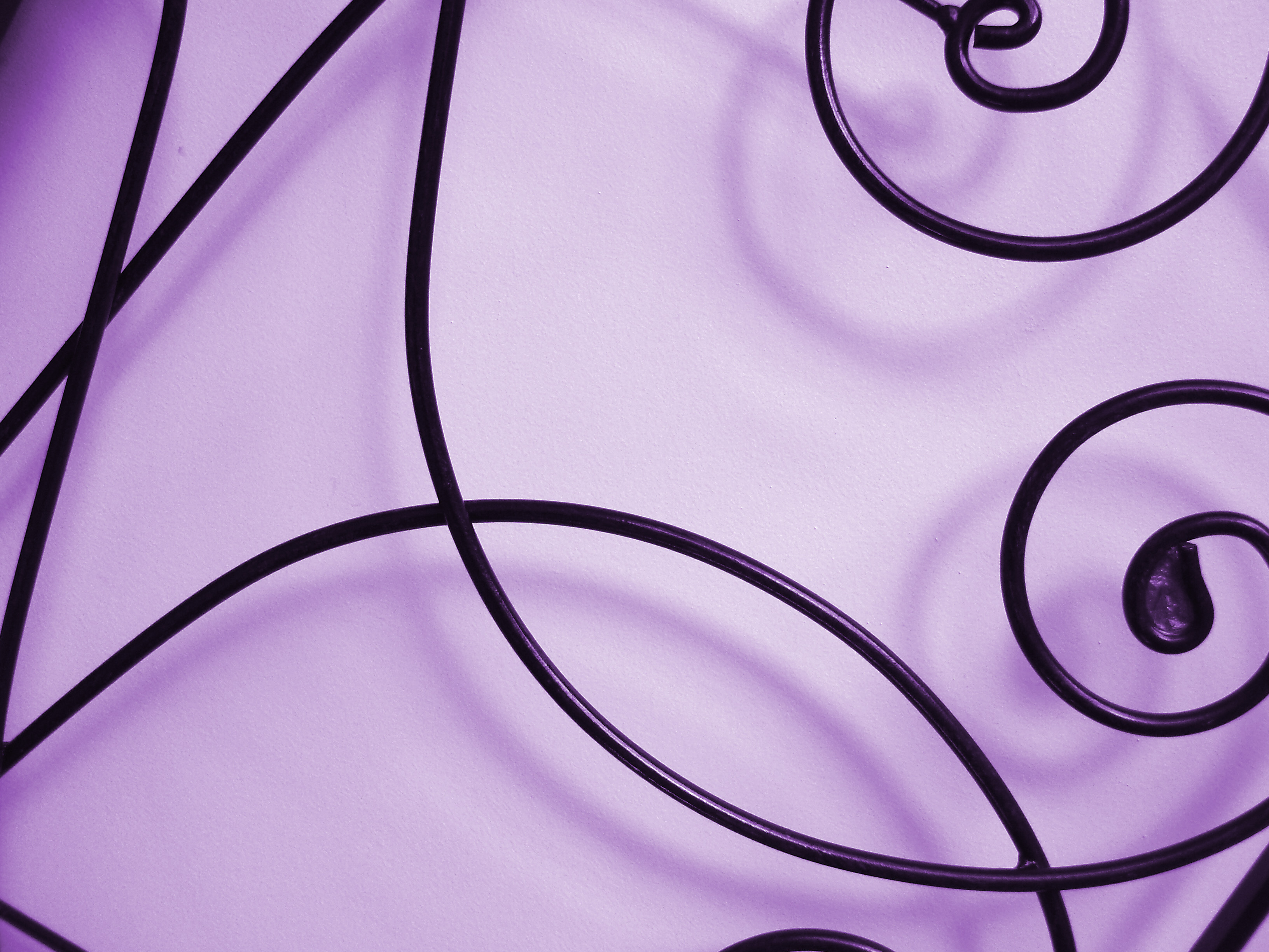 purple background with orante metal crisscrossing lines