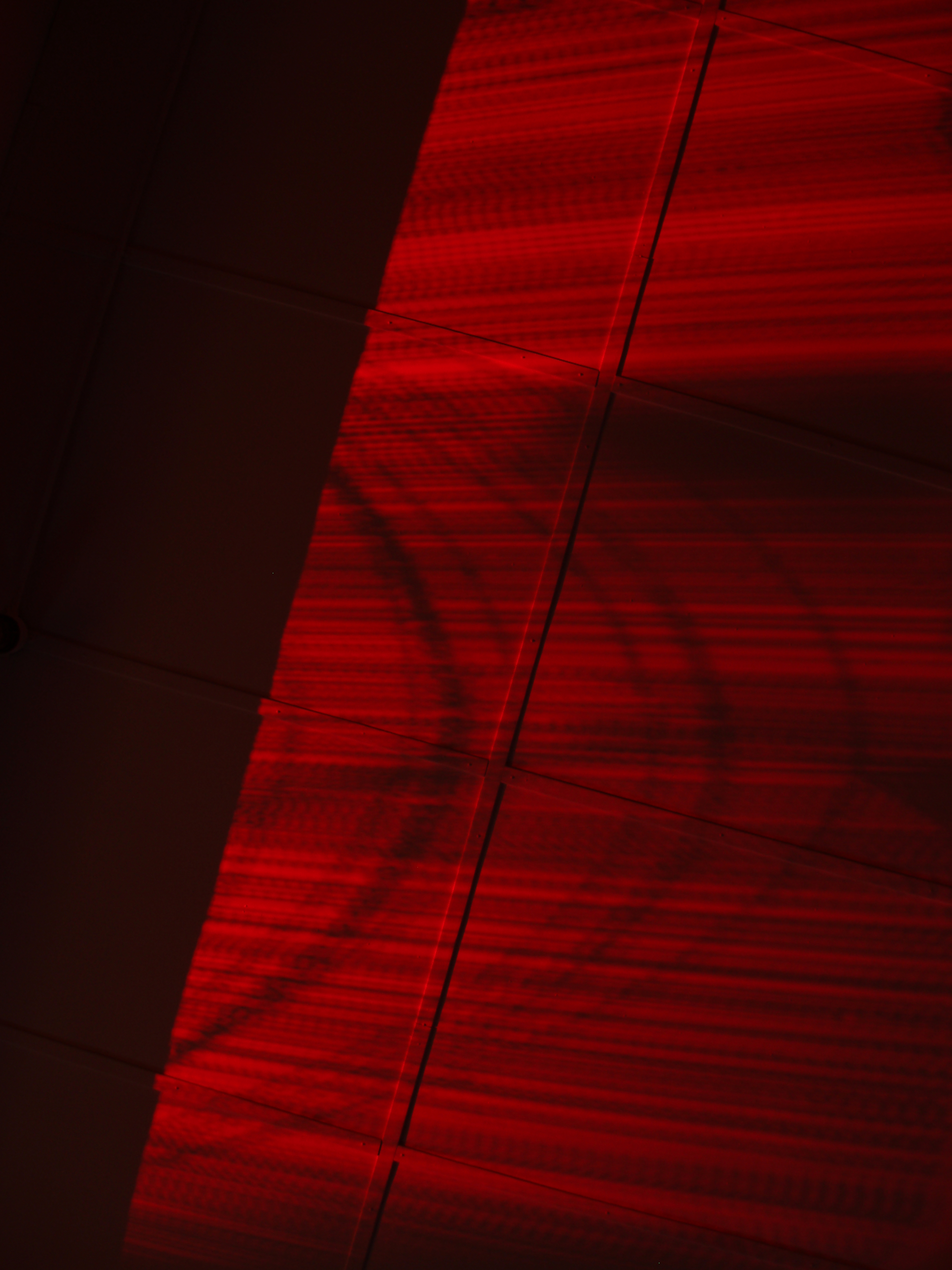 abstract patterns on the ceiling made by a red light