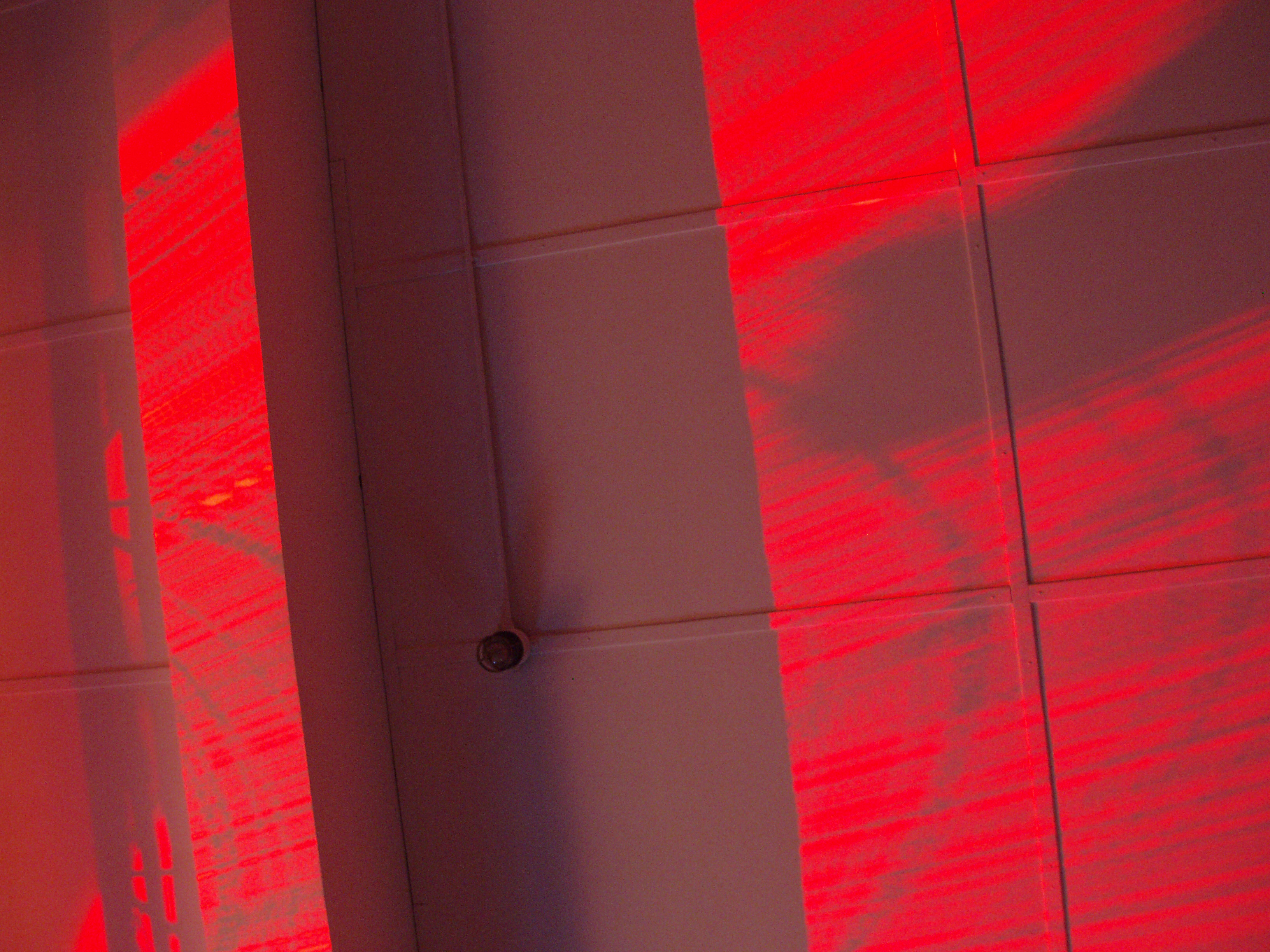 patterns on the ceiling made by a red light